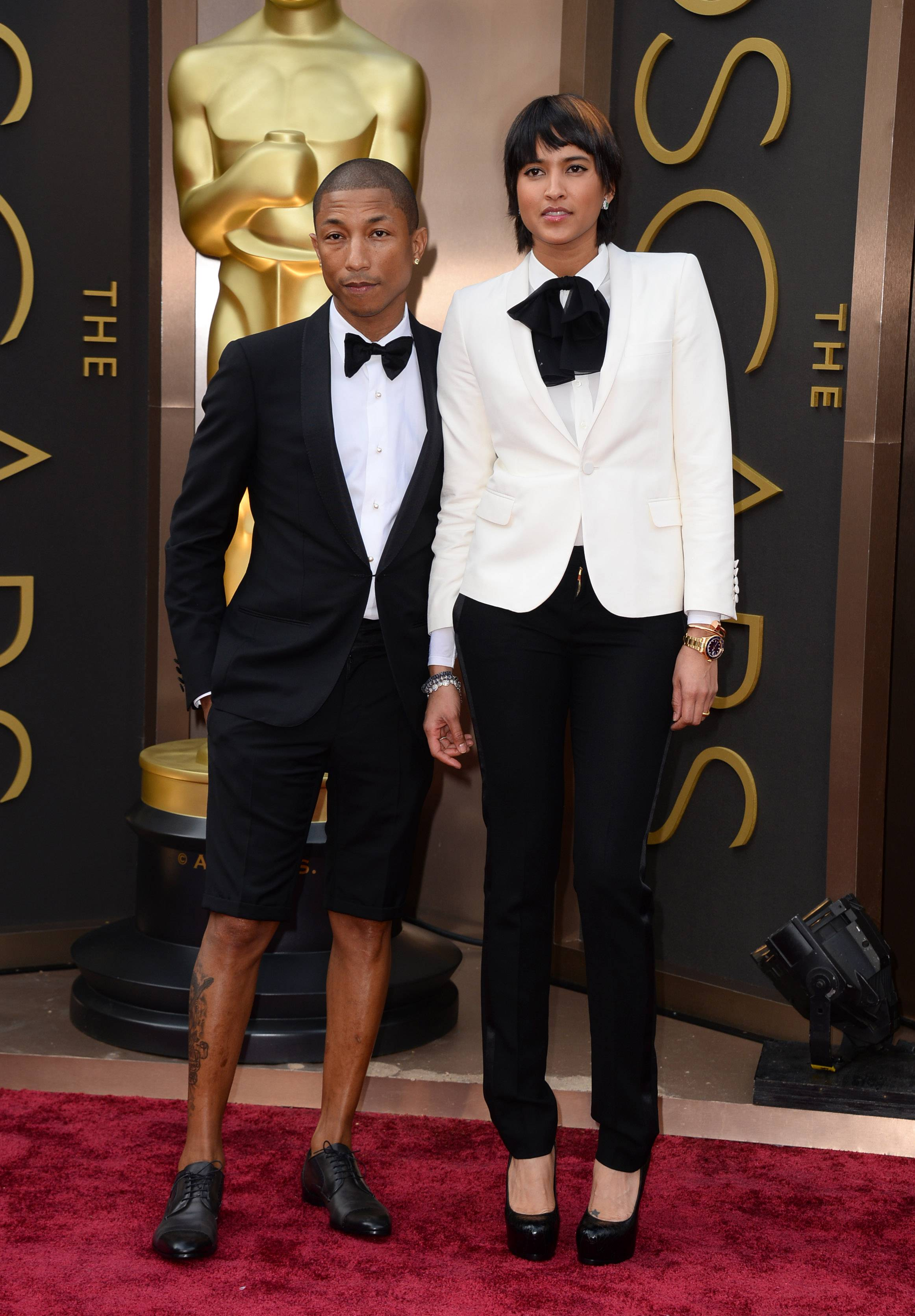 Well, it's not a hat! Pharrell Williams makes a fashion statement this time with shorts as he walks the red carpet with Helen Lasichanh at the Oscars on Sunday.