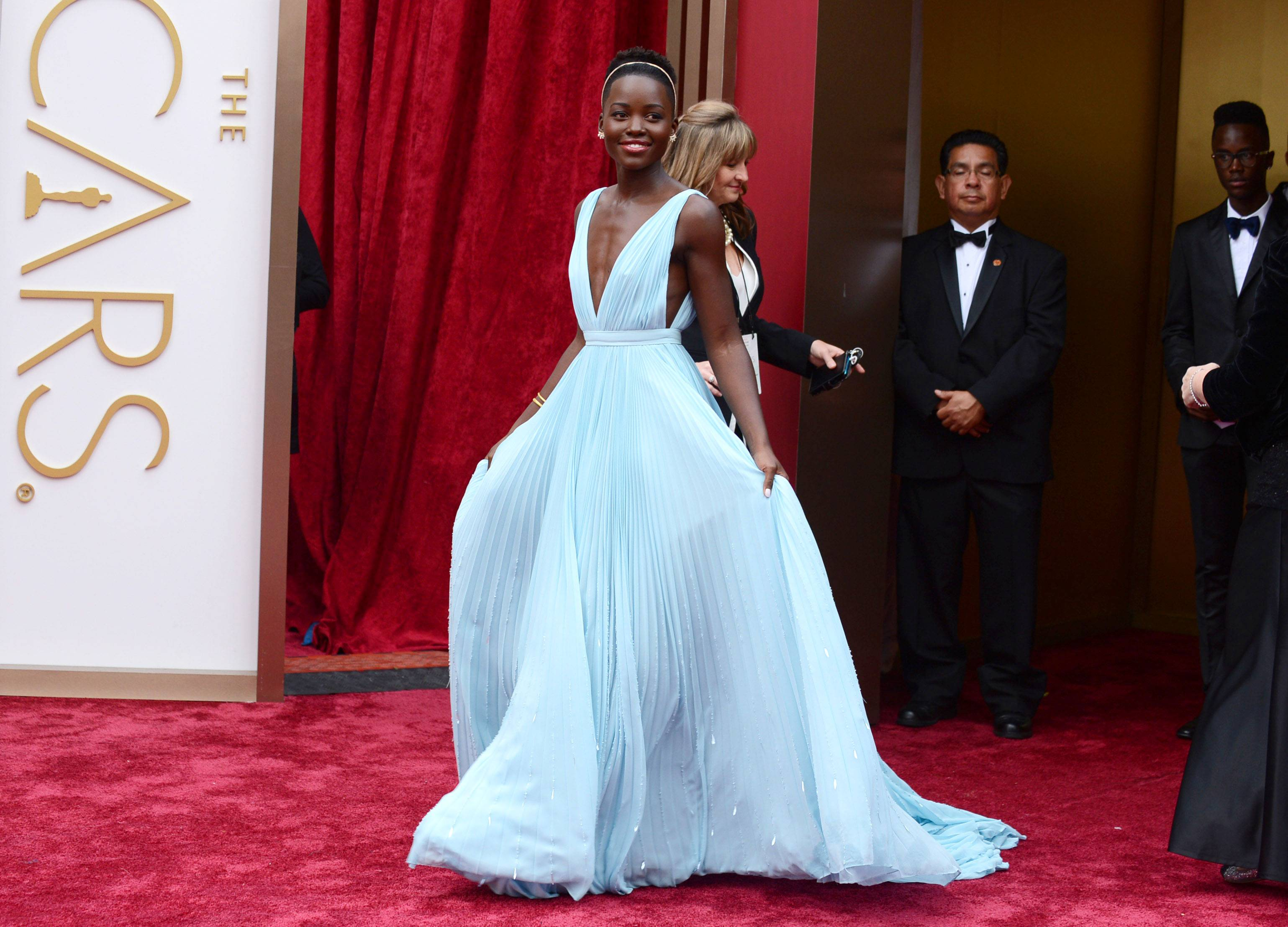 """12 Years a Slave"" and Oscar nominee Lupita Nyong'o looks every bit the belle of the ball in this pastel gown. Nyong'o hasn't made a fashion misstep yet this award season."