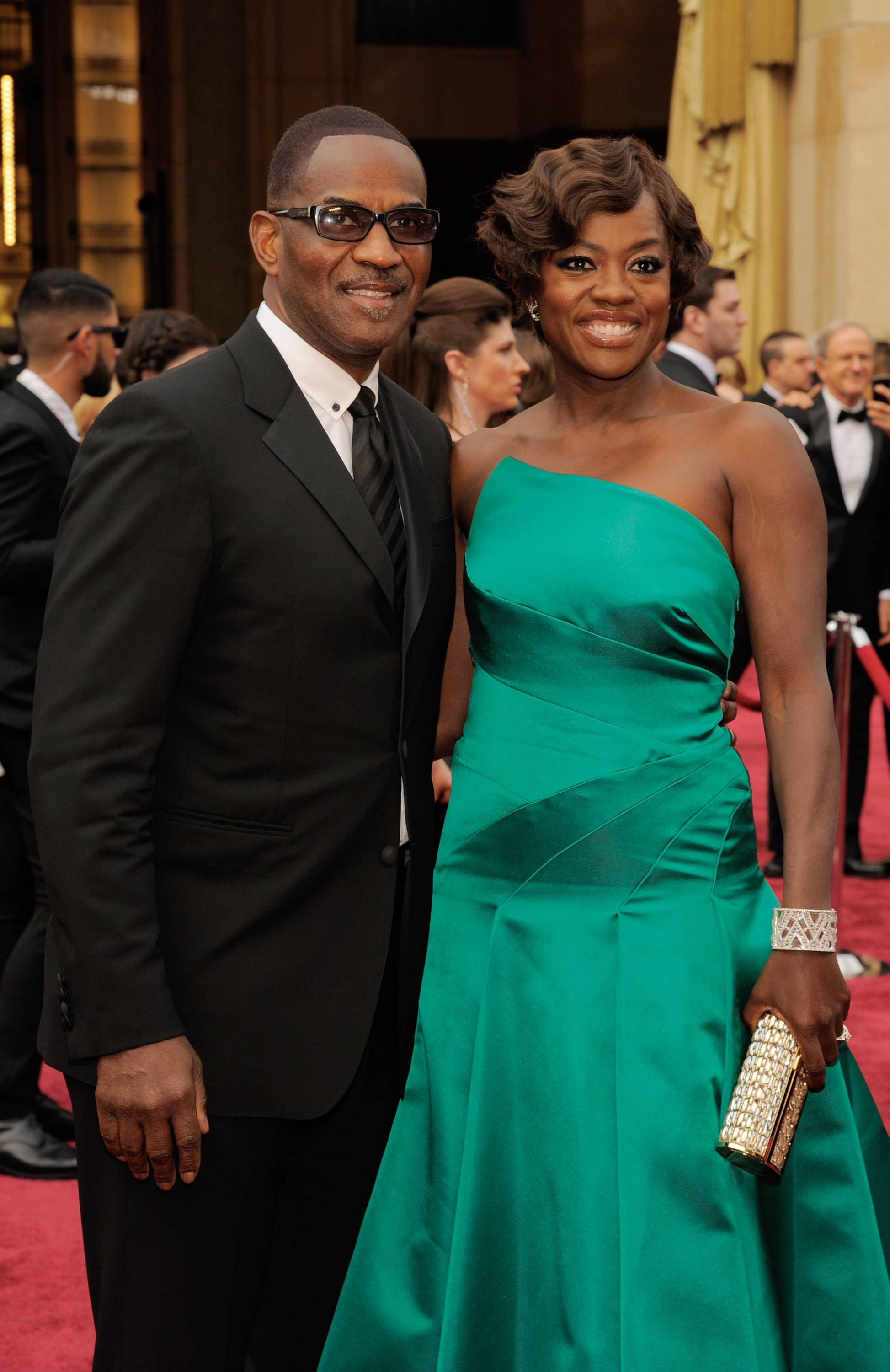 Julius Tennon, left, and Viola Davis arrive at the Oscars on Sunday at the Dolby Theatre in Los Angeles.