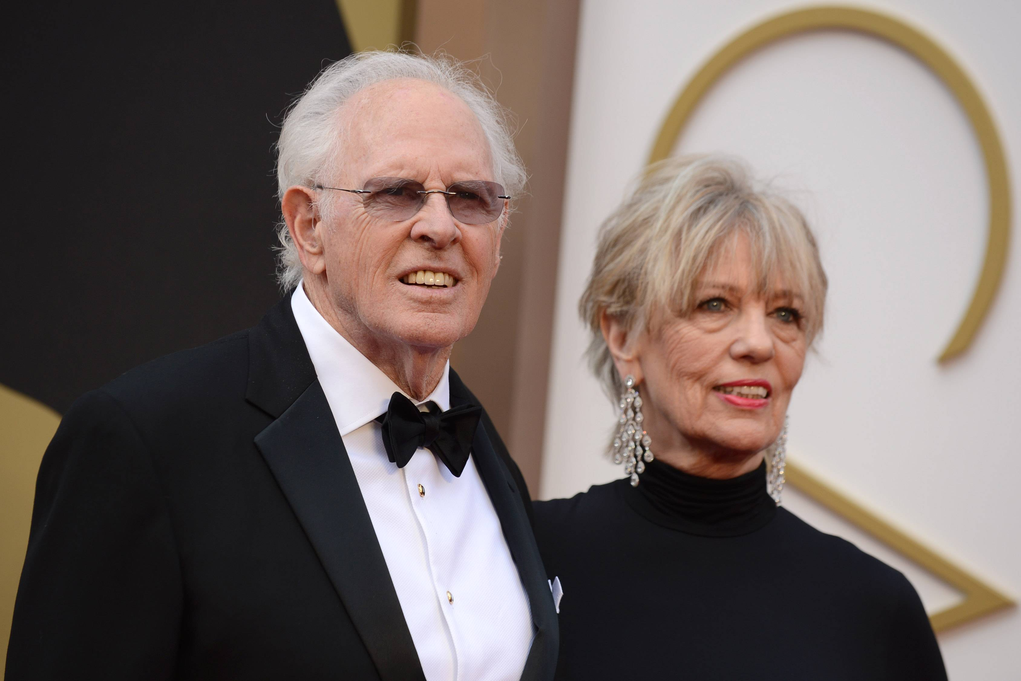 "Bruce Dern, nominated for his role in ""Nebraska"" and Andrea Beckett walk the red carpet before making their way into the Dolby Theatre."