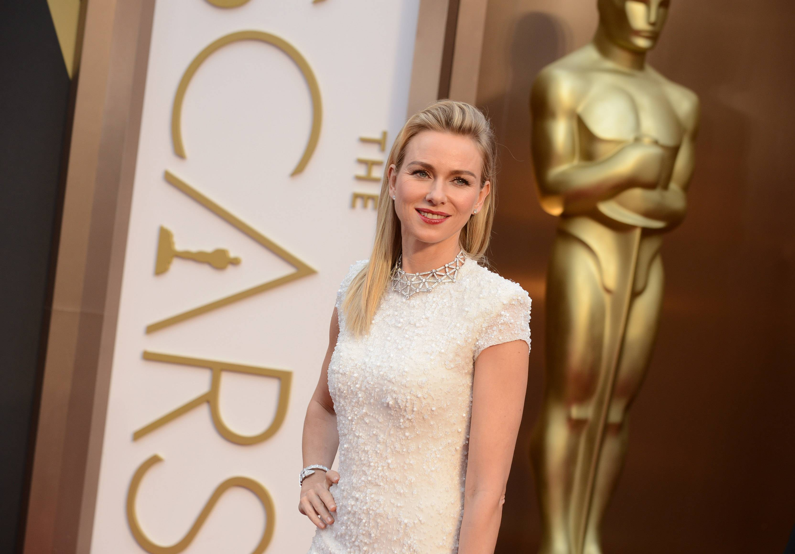 Naomi Watts shows off her Calvin Klein gown at the Oscars on Sunday in Los Angeles.
