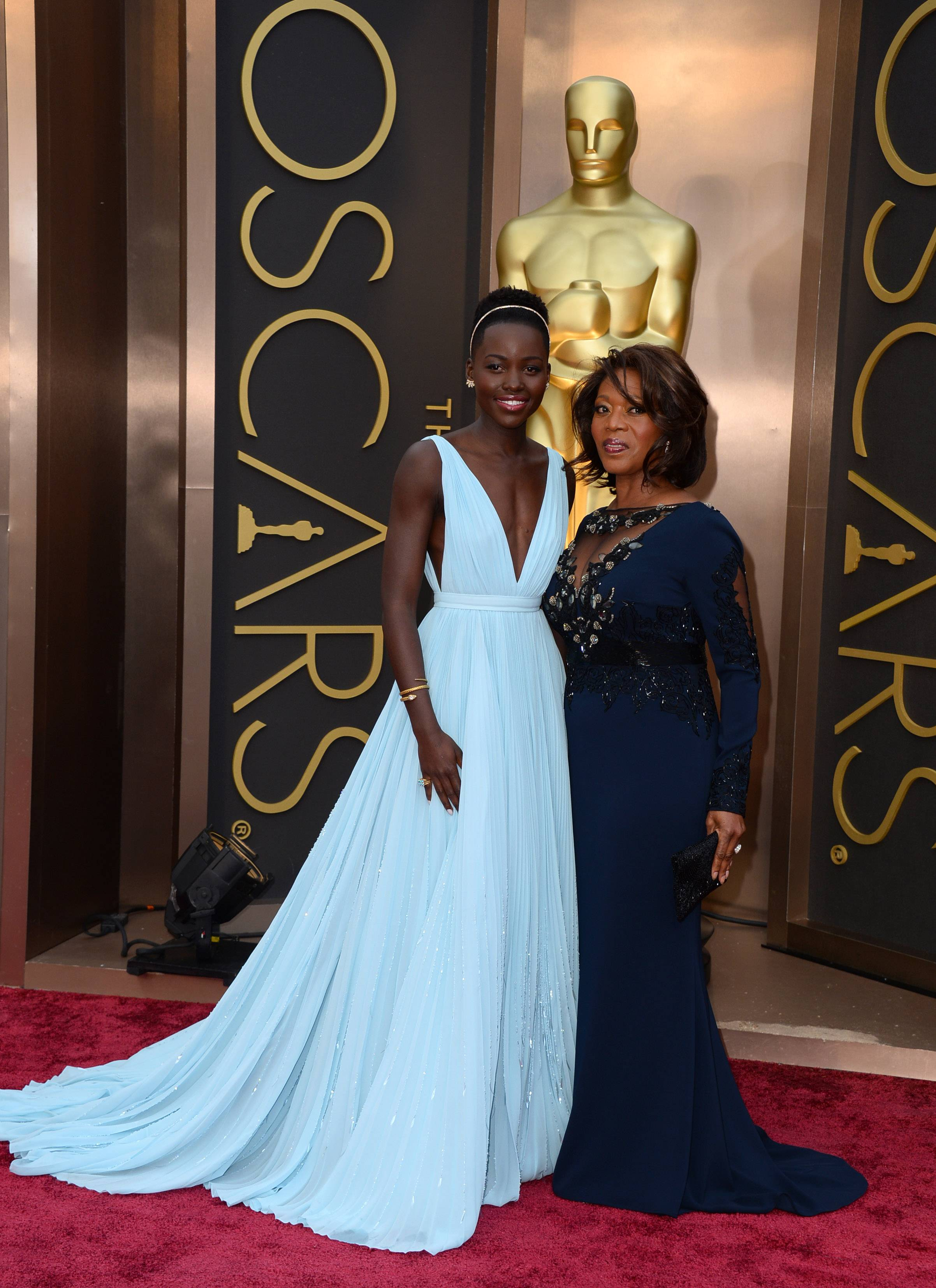 Lupita Nyong'o, left, and Alfre Woodard pose for photographers on the Oscar red carpet.