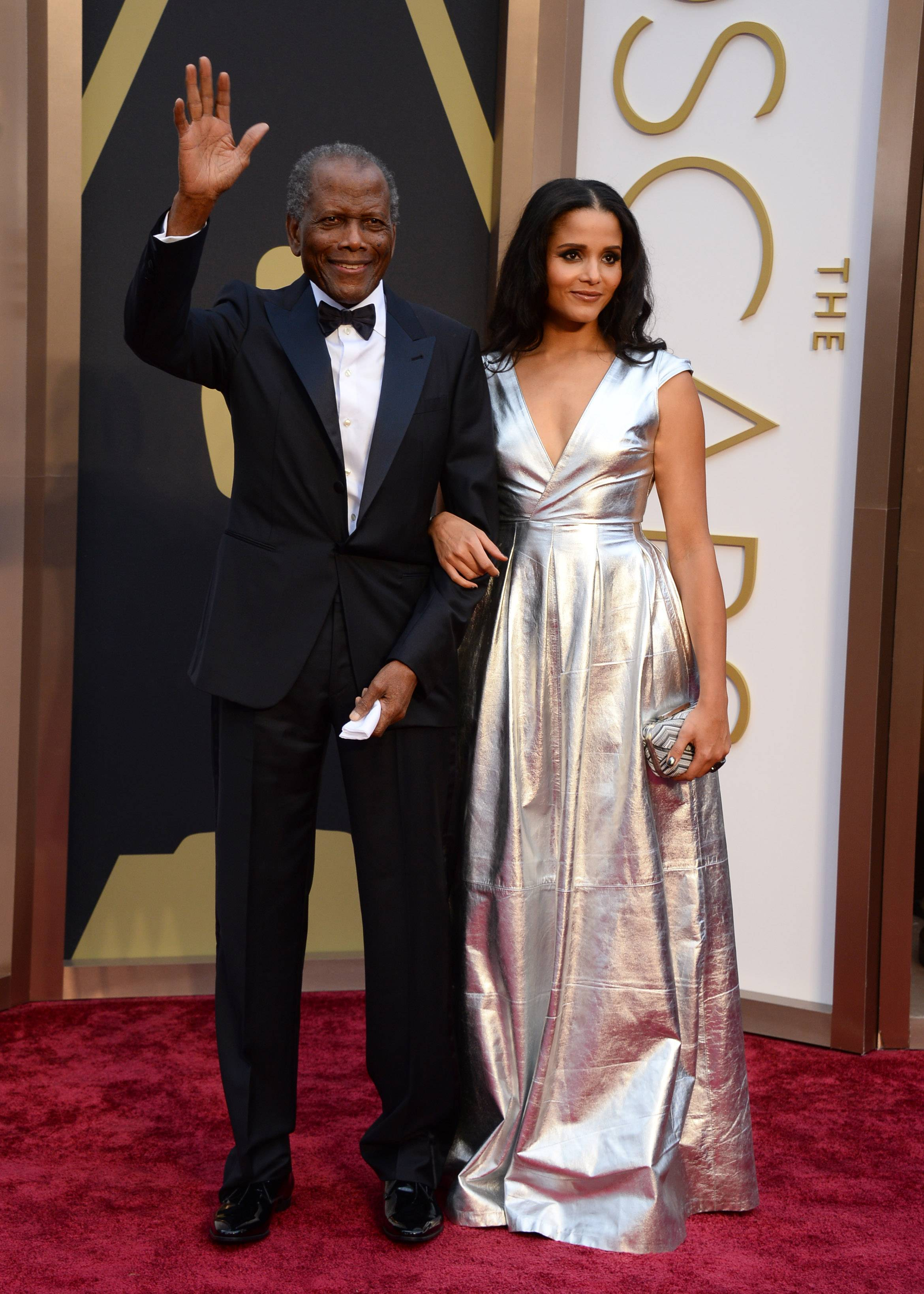 Sidney Poitier, left, and his daughter Sydney Tamiia Poitier walk the red carpet together Sunday at the Oscars.