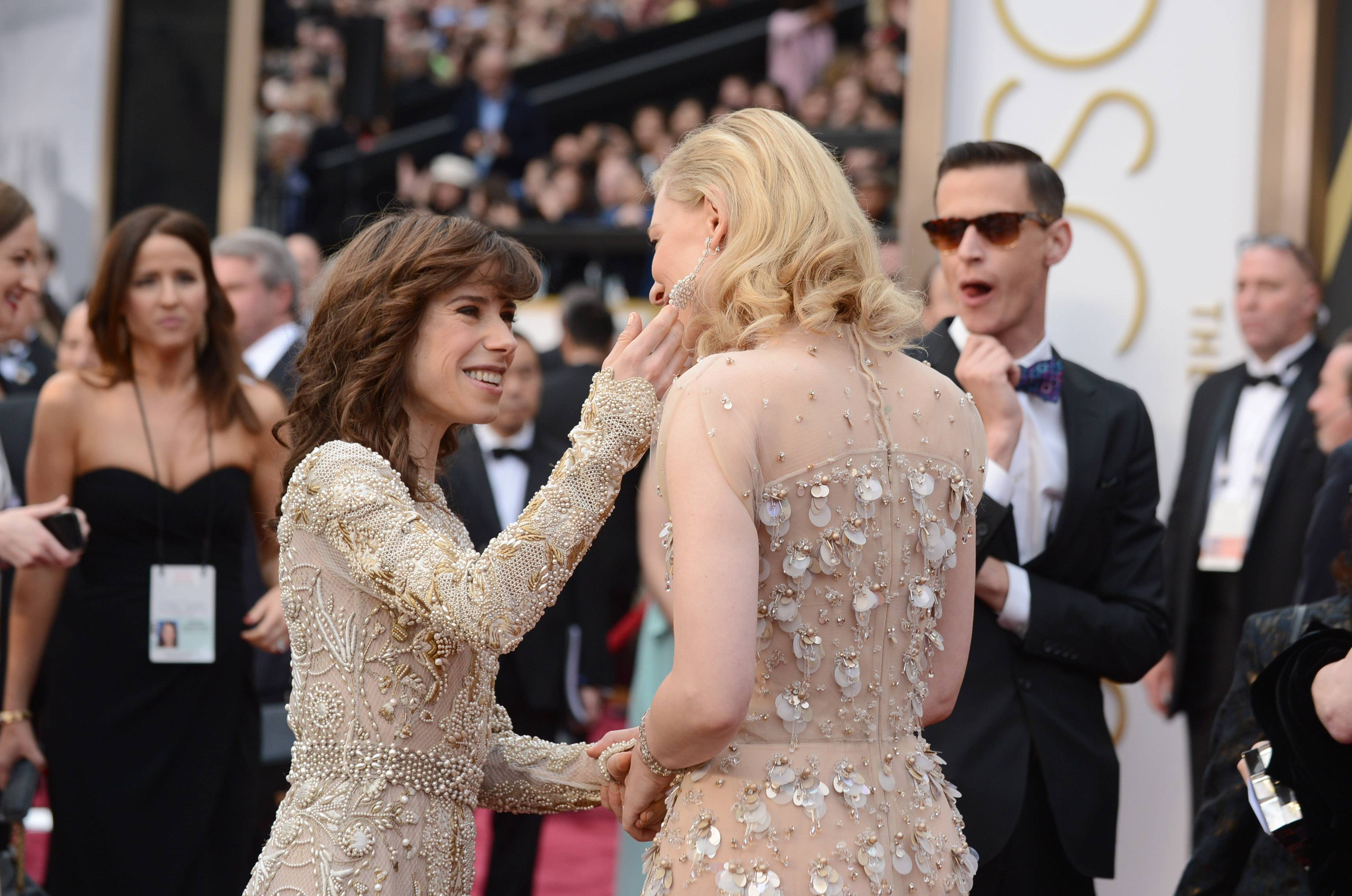 "Sally Hawkins, left, greets ""Blue Jasmine"" co-star Cate Blanchett along the red carpet at the Oscars. Both actresses are nominated for their roles in Woody Allen's film."