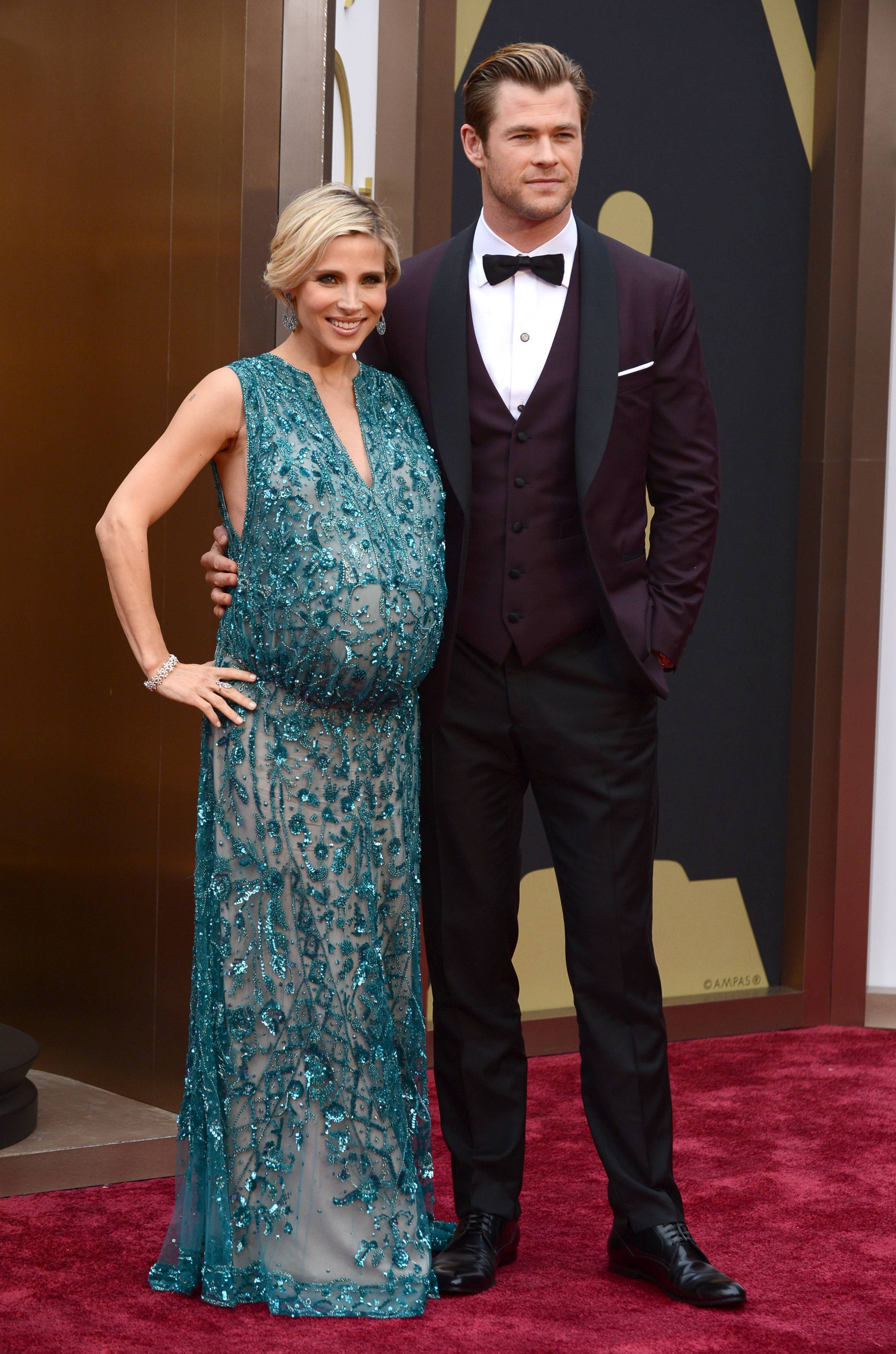 Elsa Pataky who's expecting twins with her husband, actor Chris Hemsworth, is all smiles as the couple make their way into the theater.