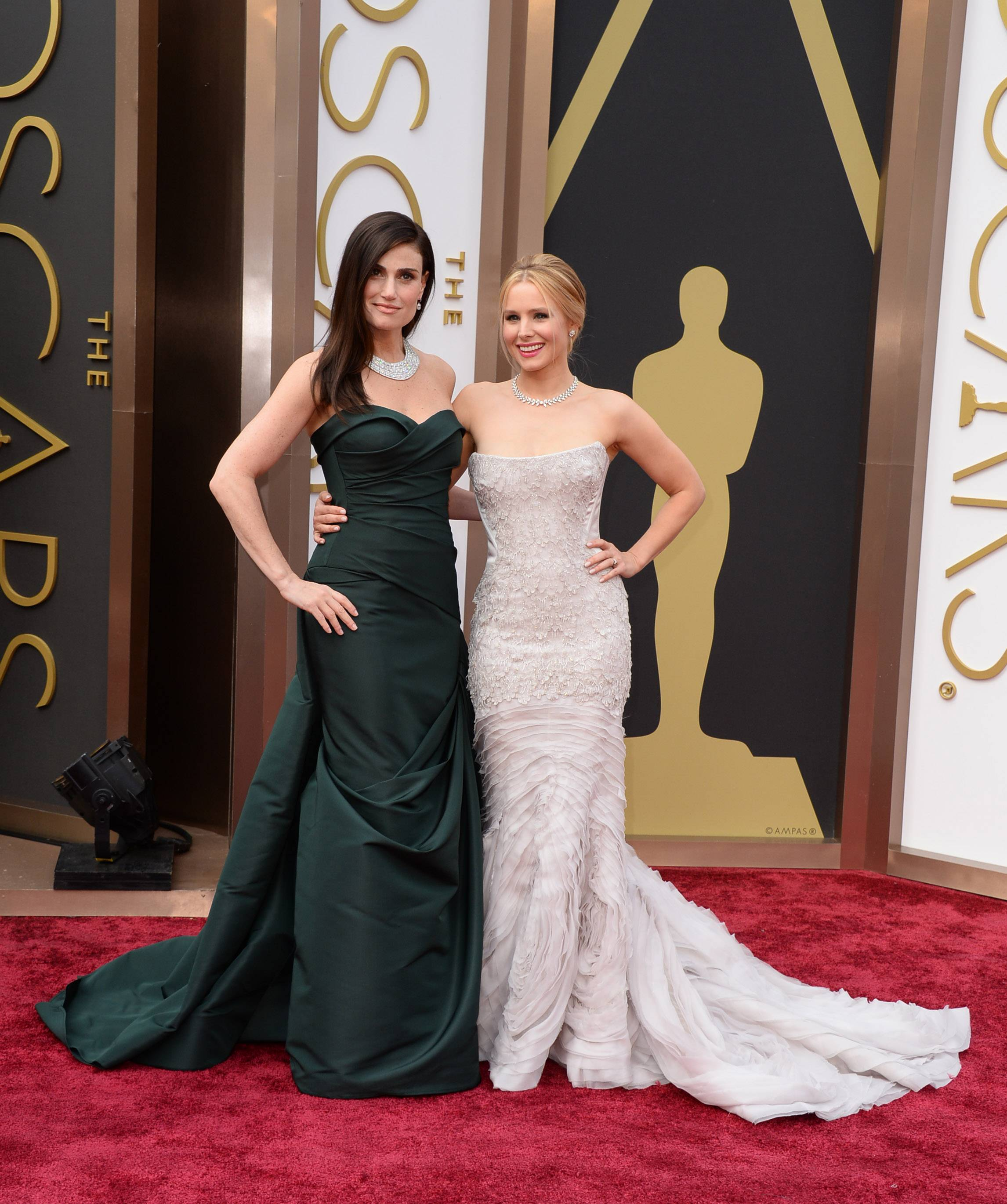 It's Elsa and Anna! Idina Menzel, left, and Kristen Bell take a moment to pose together for photographers at the Oscars on Sunday at the Dolby Theatre in Los Angeles.