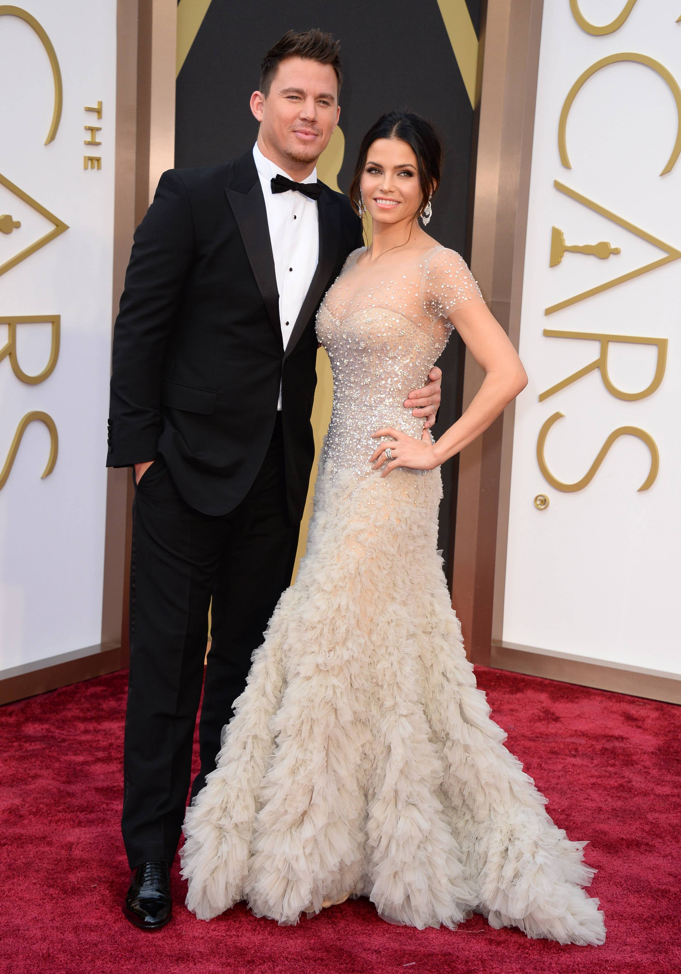Actor Channing Tatum  and his wife, actress Jenna Dewan, arrive at the Oscars on Sunday.