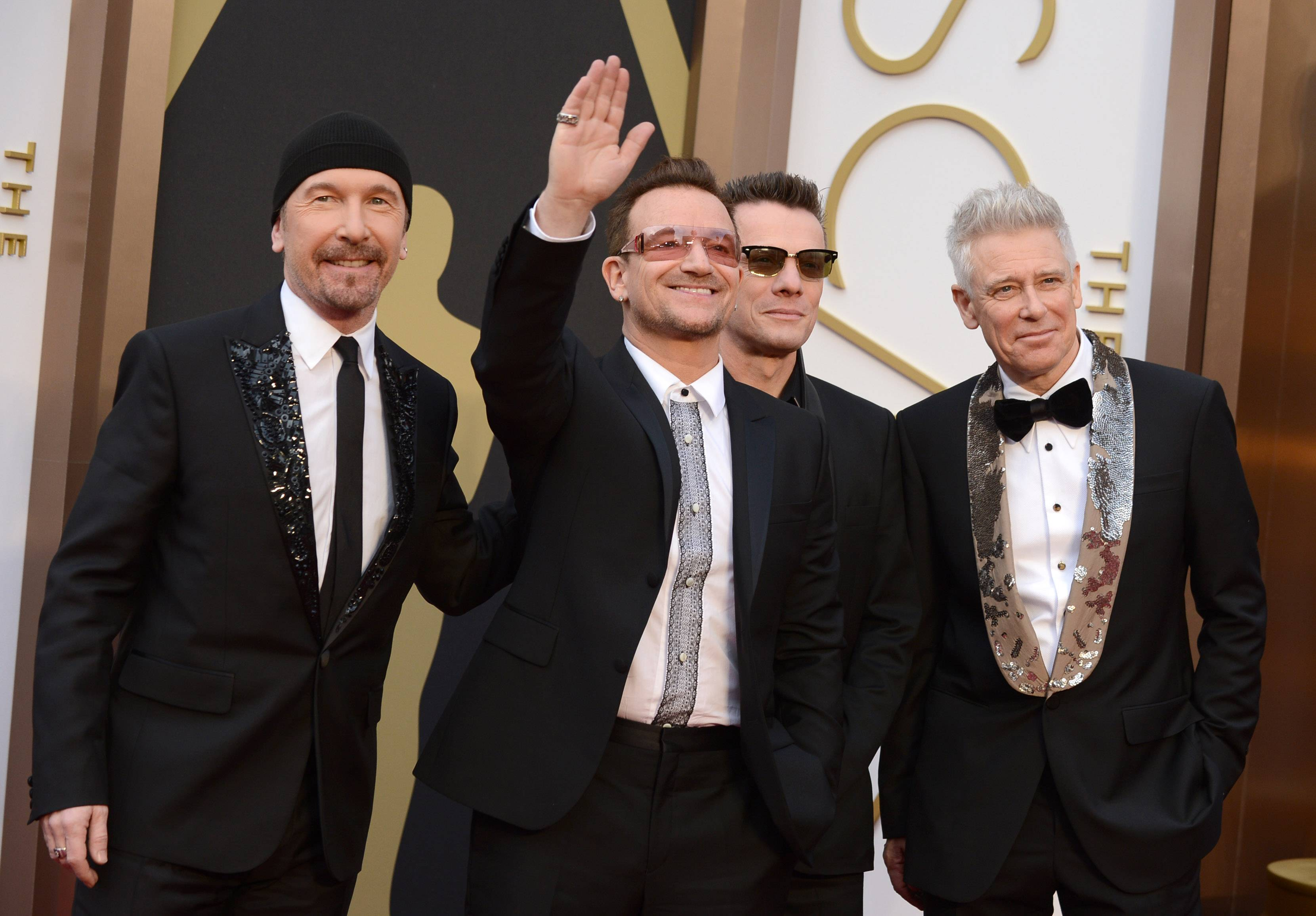 The Edge, from left, Bono, Larry Mullen, Jr., and Adam Clayton of U2 arrive at the Oscars on Sunday.