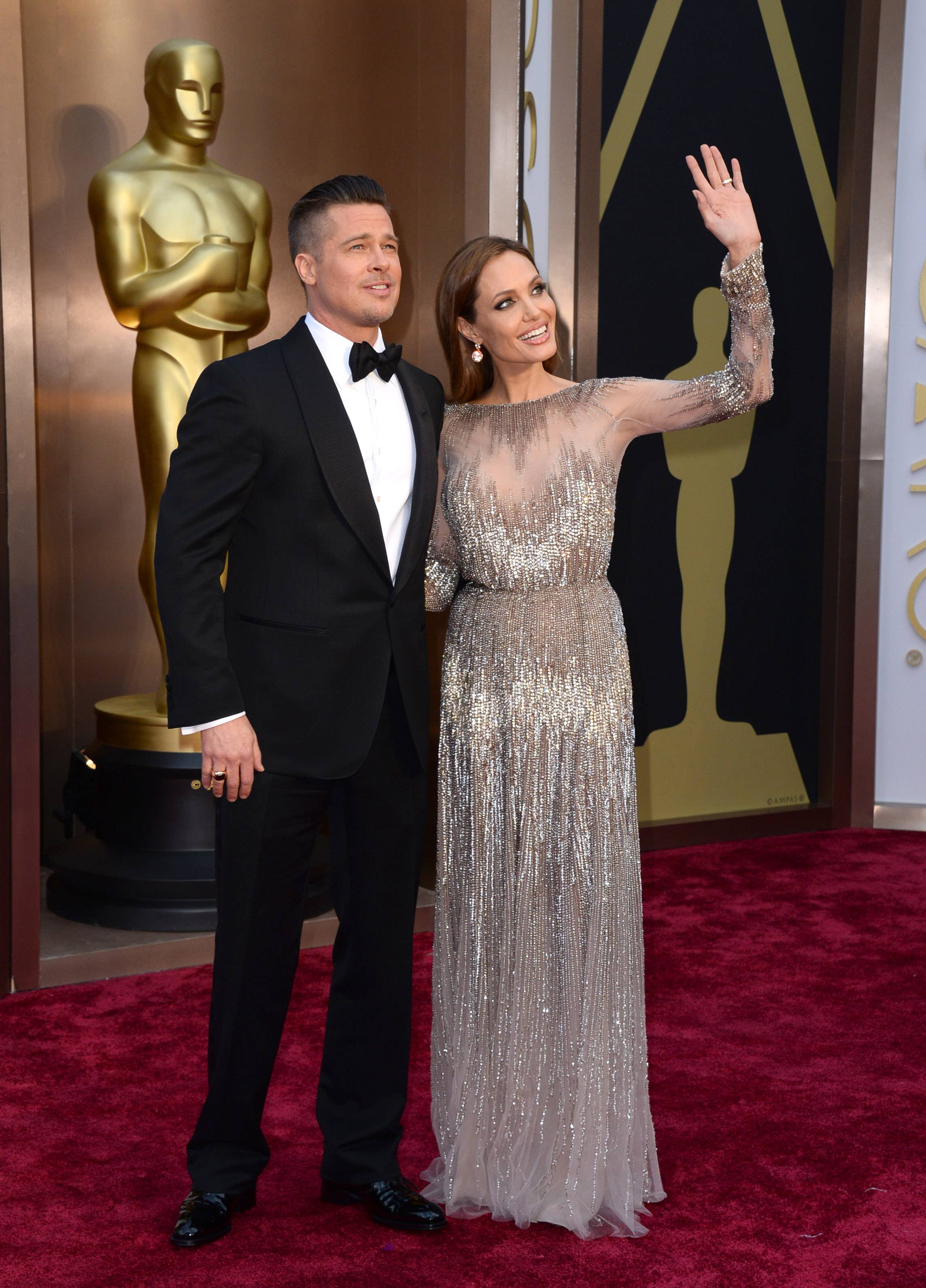 One of Hollywood's hottest couples Brad Pitt and Angelina Jolie salute the fans on Sunday at the Oscars.