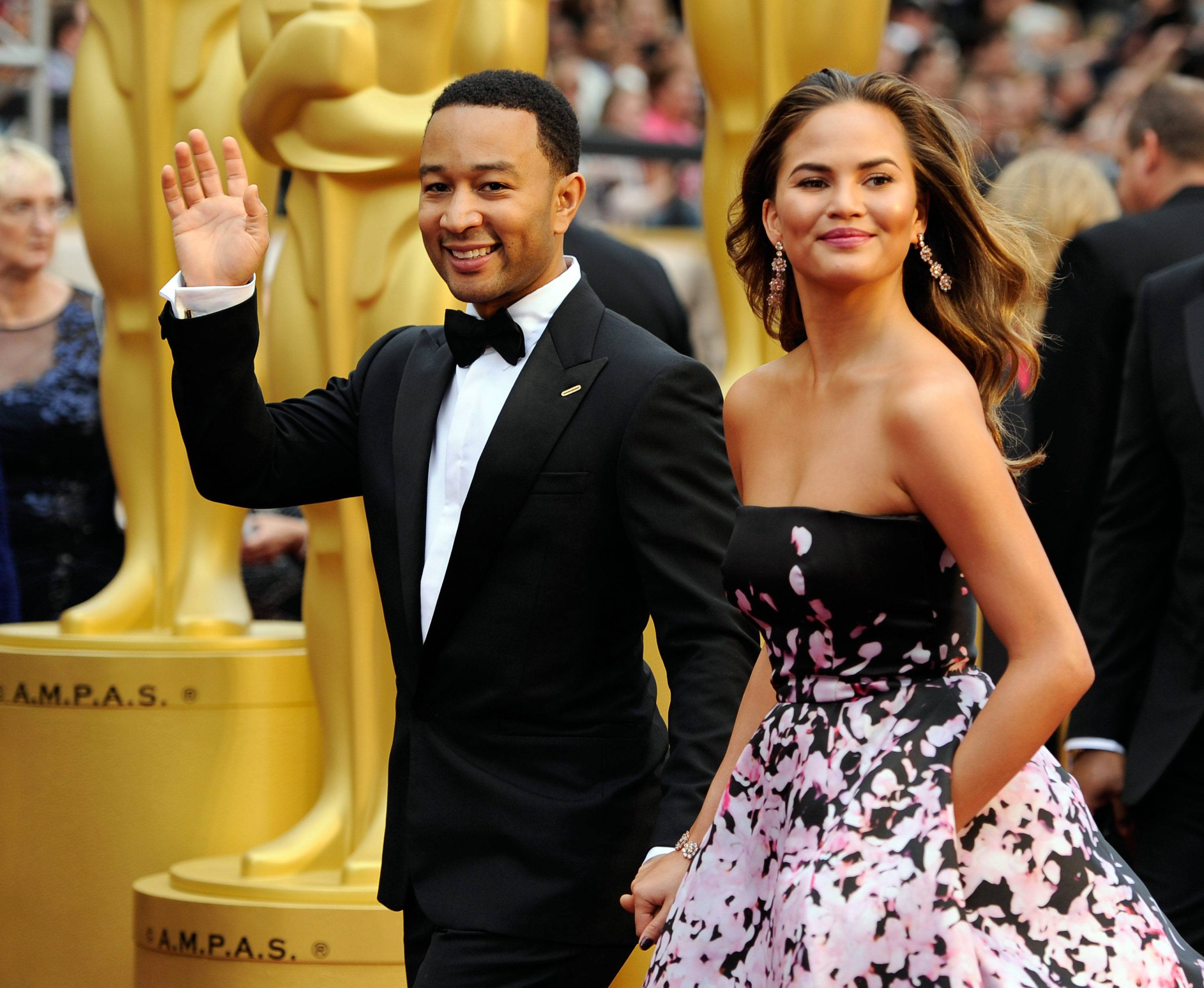Musician John Legend and his wife, model Christine Teigen, arrive at the Oscars on Sunday.
