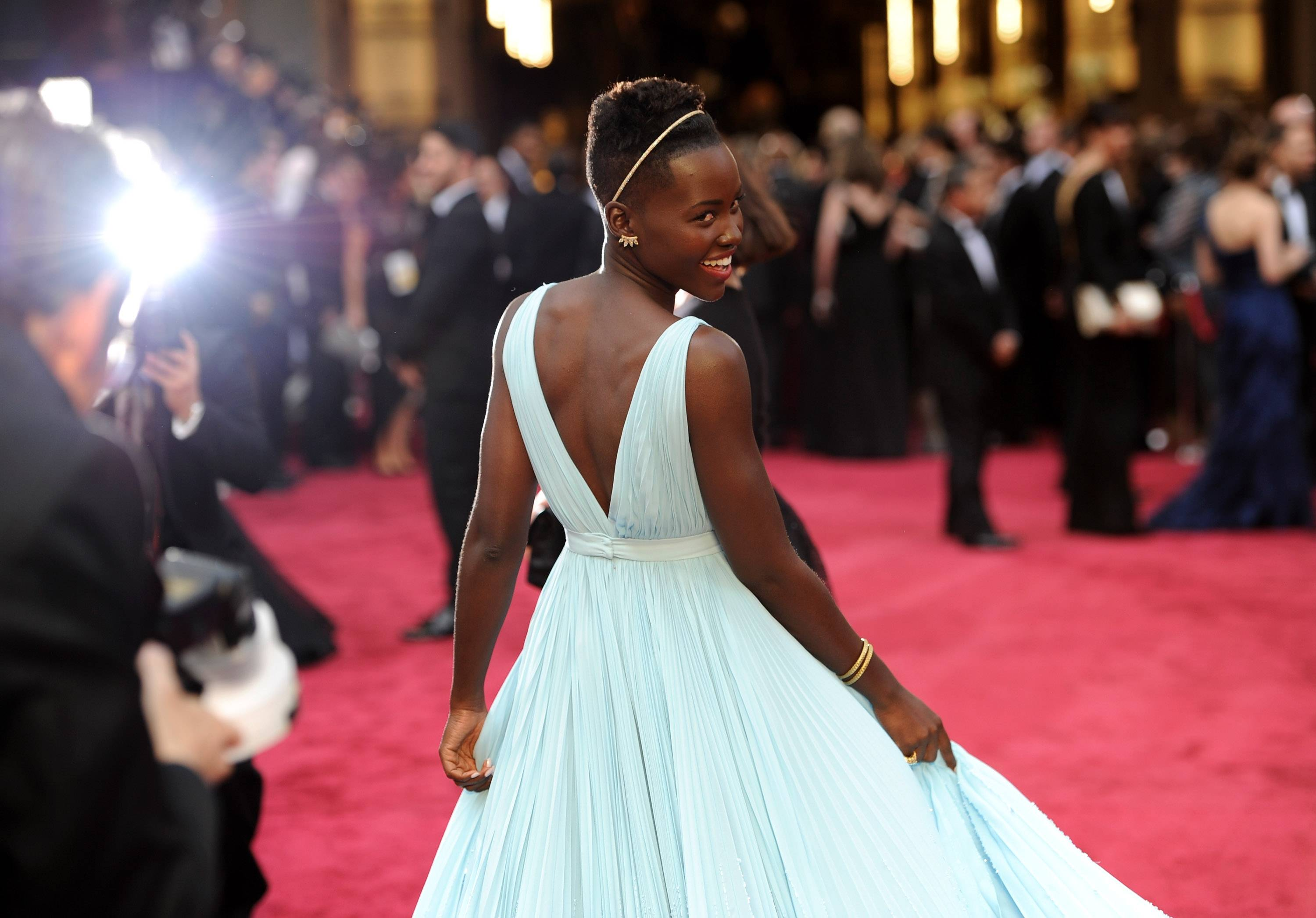 Oscar nominee Lupita Nyong'o looks every bit the Hollywood star as she makes her way down the red carpet.