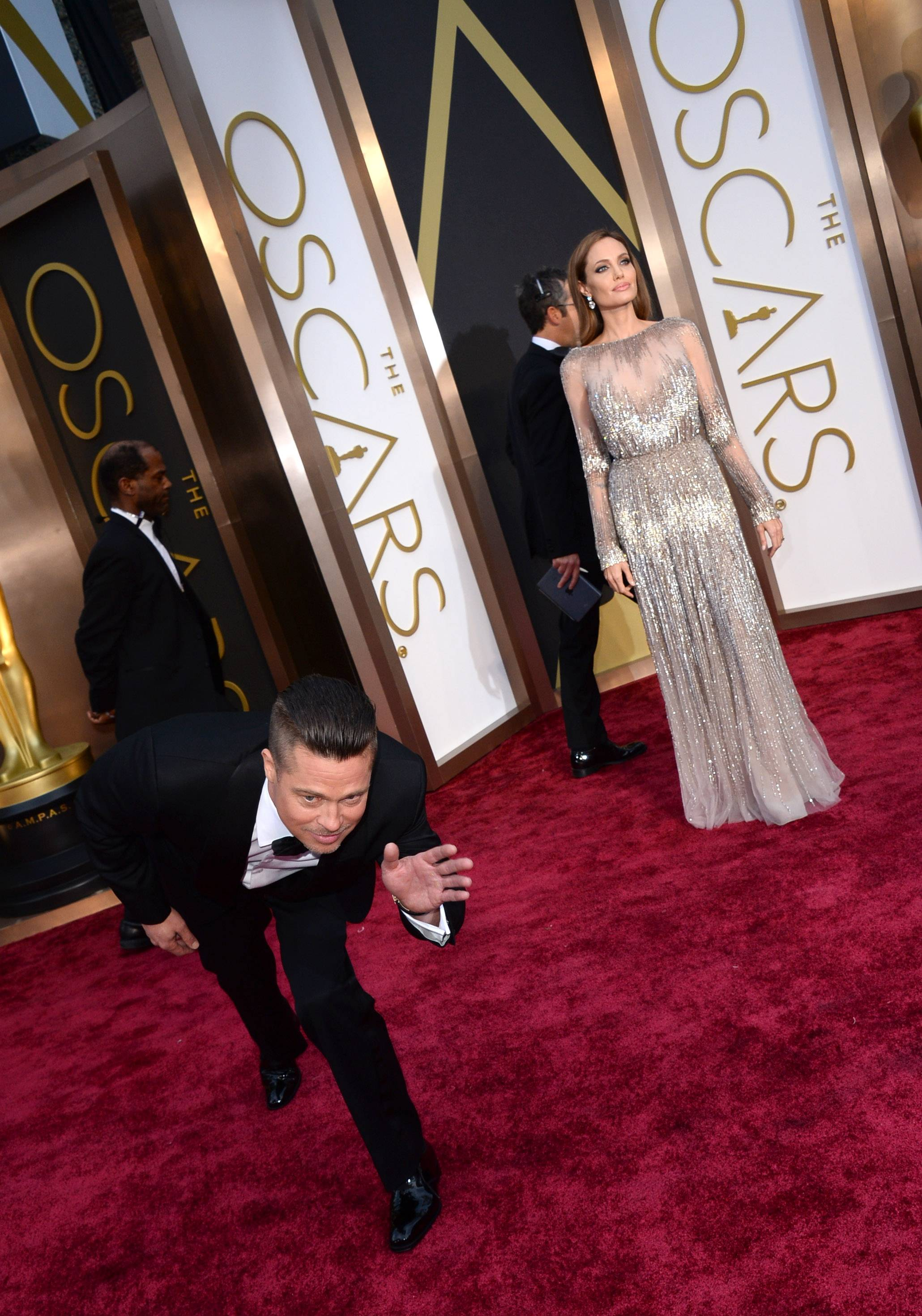 Brad Pitt shows a bit of his silly side while working the red carpet with his lady Angelina Jolie.