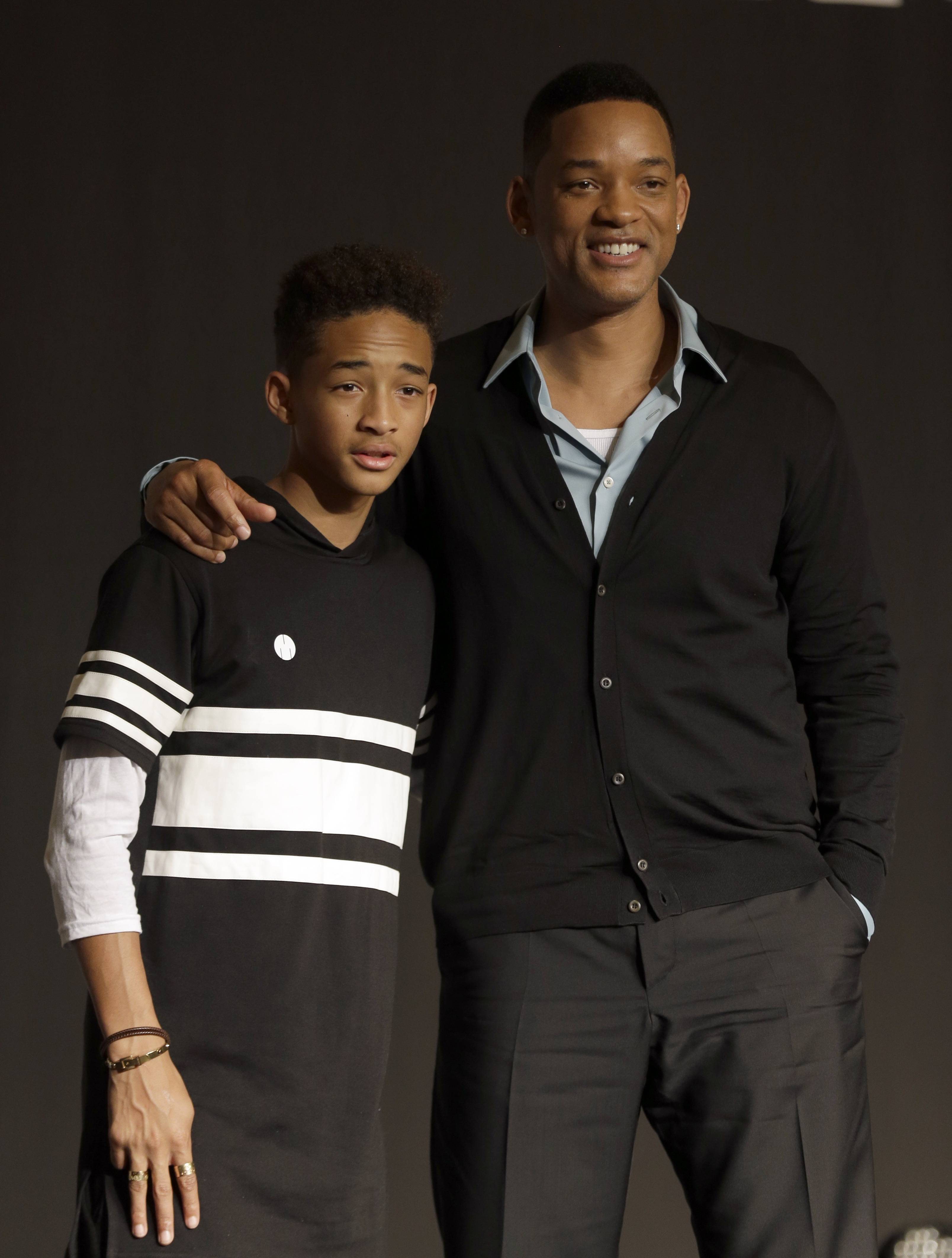 "FILE - In this May 7, 2013 file photo, U.S. actor Will Smith and his son Jaden pose for the media after press conference for their film ""After Earth"" in Seoul, South Korea. Both actors were awarded Razzies for the film. Jaden was selected as worst actor for his role in the sci-fi flop about a father and son stranded on an untamed earth, while the elder Smith was chosen as worst supporting actor at the Golden Raspberry Awards, on Saturday, March 1, 2014, which lampoons Hollywood's awards season on the eve of the Oscars."