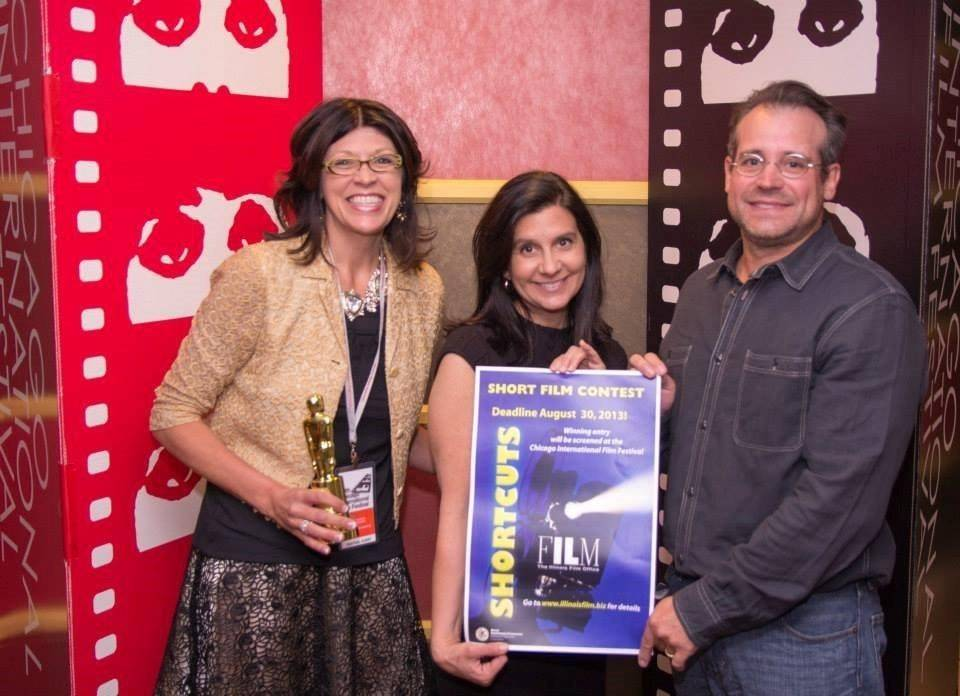 "Kevin and DeAnna Cooper pose on the Chicago International Film Festival red carpet with Illinois Film Office Managing Director Betsy Steinberg, center. The Coopers' film, ""The Painter,"" is now making the rounds through film festivals around the country."