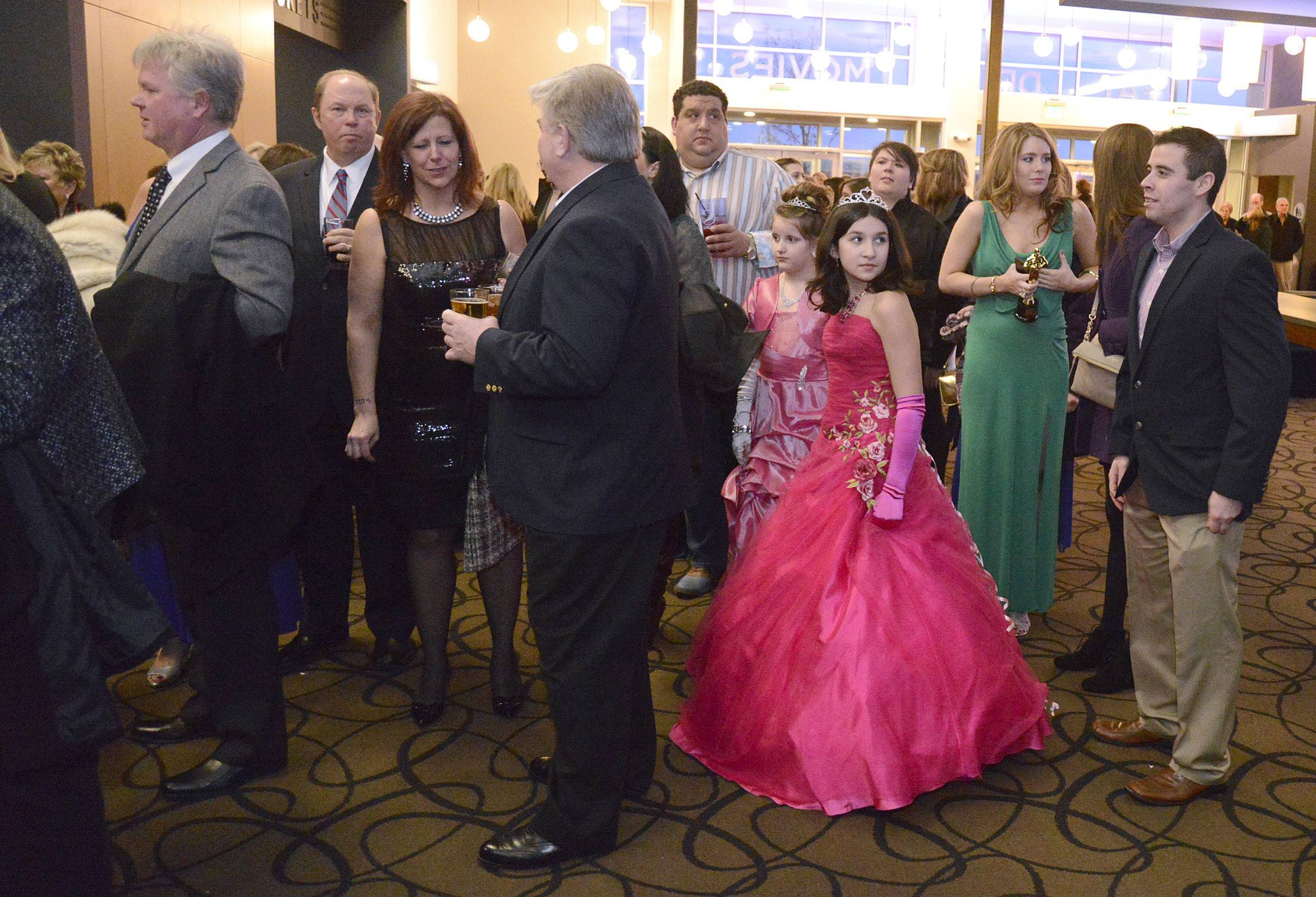 Wearing hot pink, Gianna Danno, 11, of Channahon waits in line for the 86th Academy Awards party at Studio Movie Grill in Wheaton on Sunday, March 2.