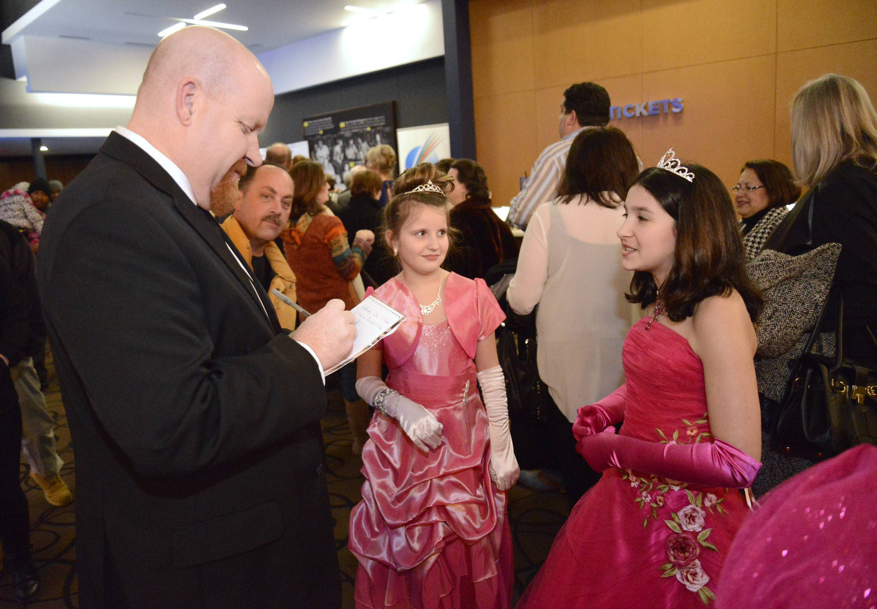 Daily Herald reporter Jake Griffin interviews Sydney Cox and Gianna Danno, both 11 and from Channahon, at the 86th Academy Awards party at Studio Movie Grill in Wheaton on Sunday, March 2.