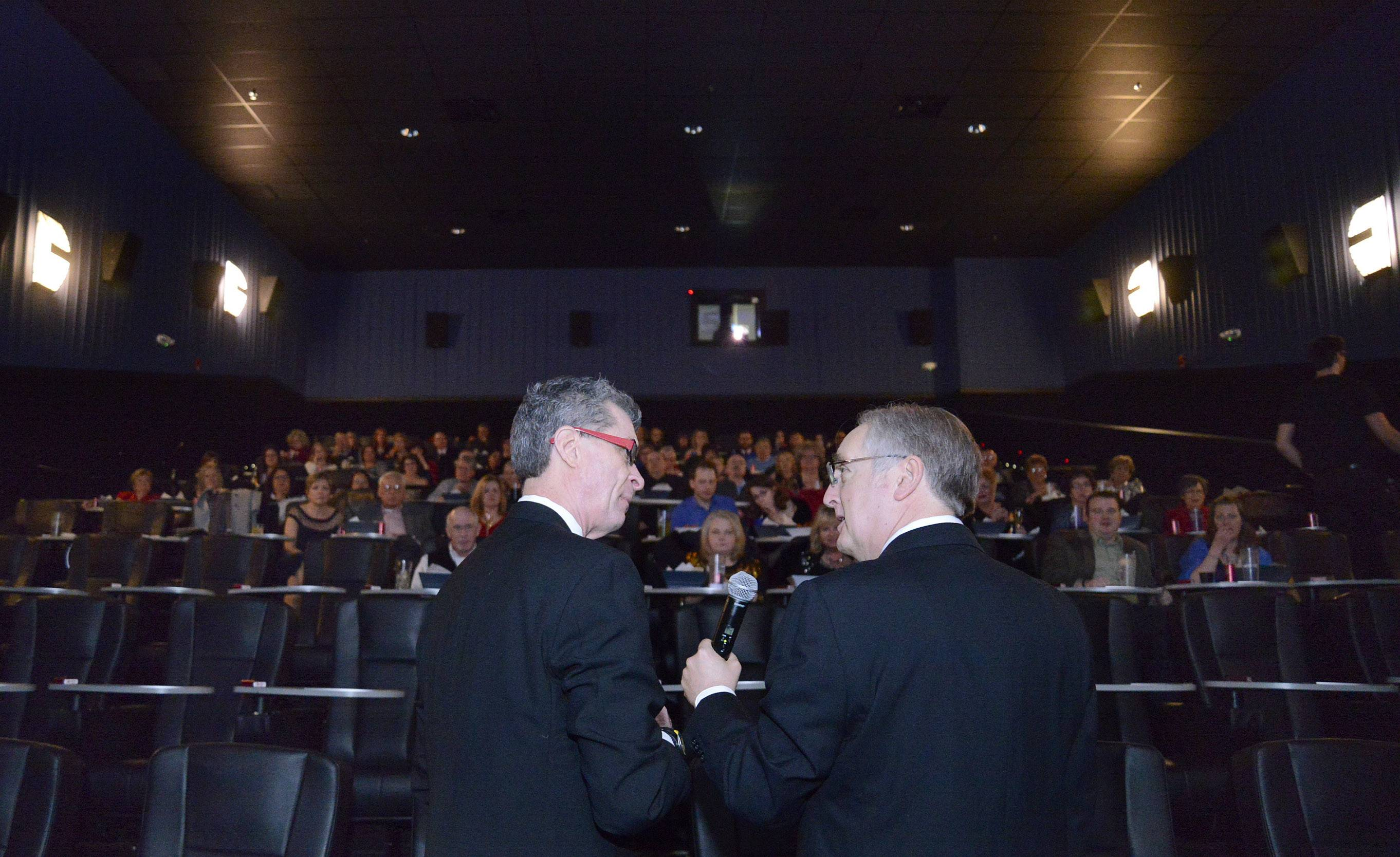 Daily Herald's Dann Gire, left, and Raymond Benson of Buffalo Grove host the 86th Academy Awards party for Daily Herald subscribers at Studio Movie Grill in Wheaton on Sunday, March 2.