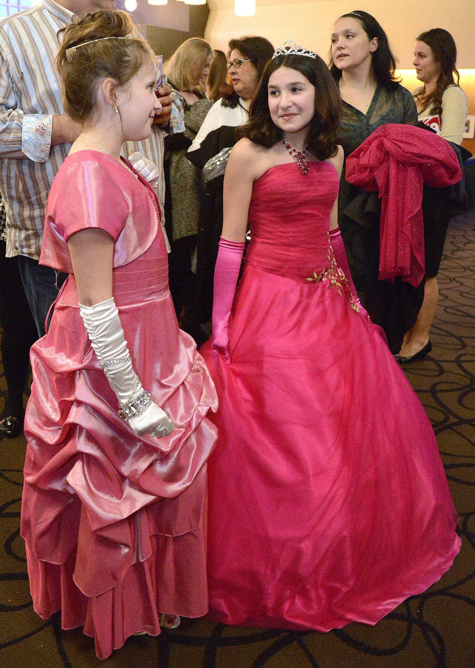 Best friends Sydney Cox and Gianna Danno, both 11 and from Channahon, dressed up special to watch the 86th Academy Awards at Studio Movie Grill in Wheaton on Sunday, March 2.