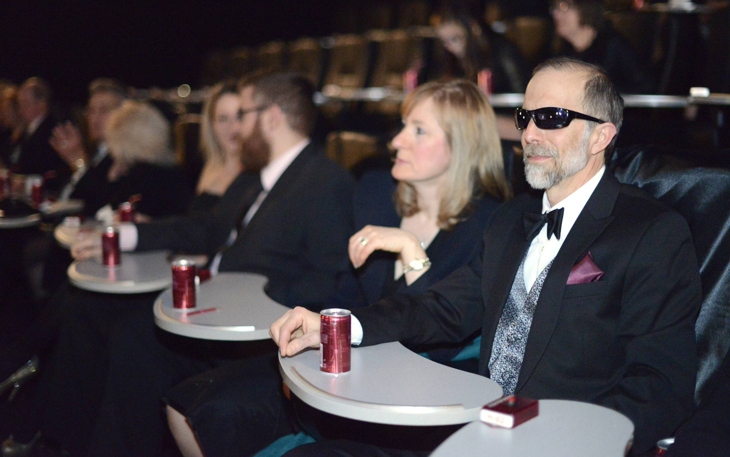 Tom Spadafora of Aurora wore movie star sunglasses to compliment his tux for the Daily Herald subscribers event of the 86th Academy Awards party hosted by Dann Gire at Studio Movie Grill in Wheaton on Sunday, March 2. He and wife, Debbie, left, have attended a previous Daily Herald event hosted by Gire.