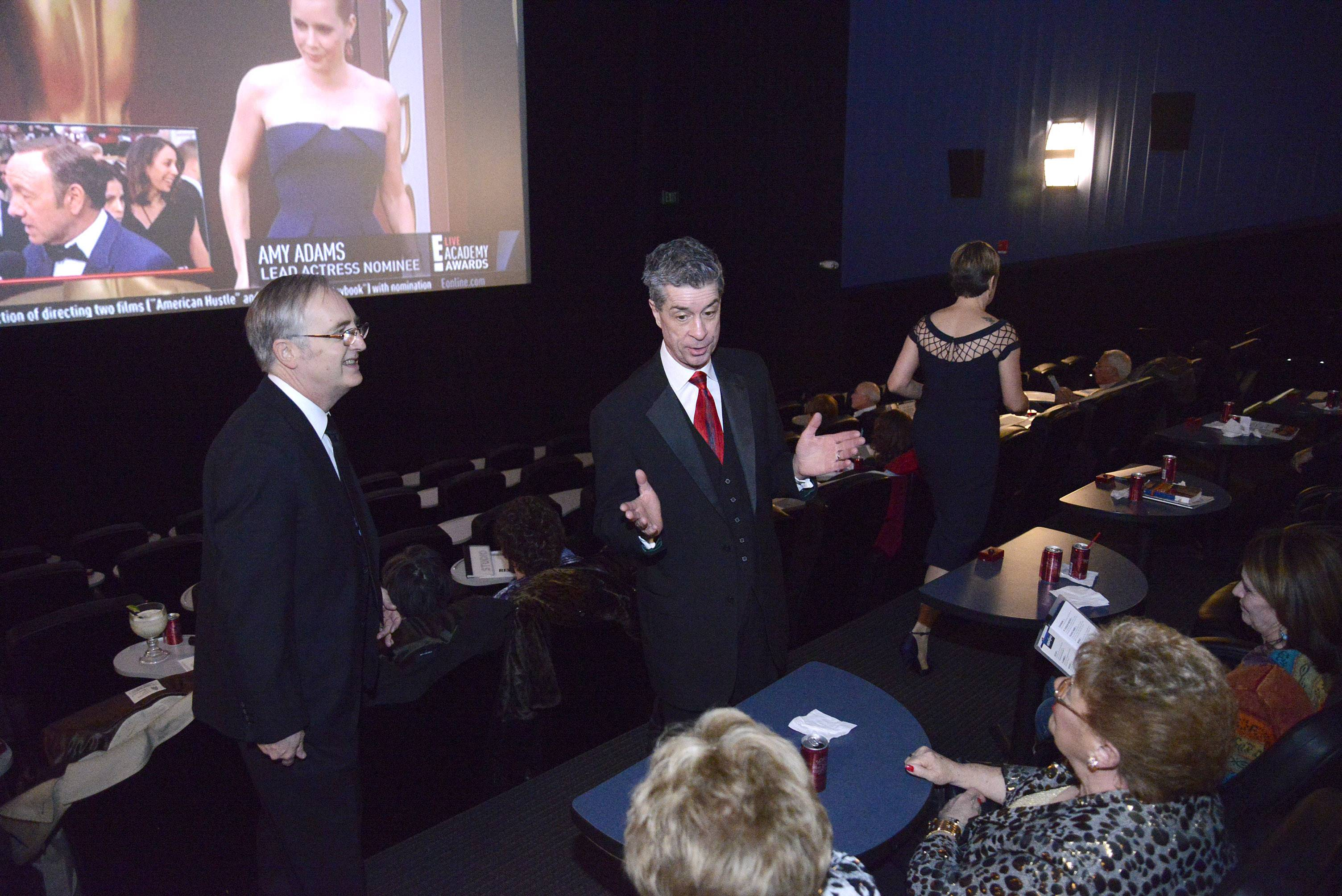 Raymond Benson of Buffalo Grove, left, and Daily Herald's Dann Gire chat with Marie Zavoli of Glendale Heights, left, and Fran Scalafini of Bloomingdale before the start of the 86th Academy Awards party at Studio Movie Grill in Wheaton on Sunday, March 2.