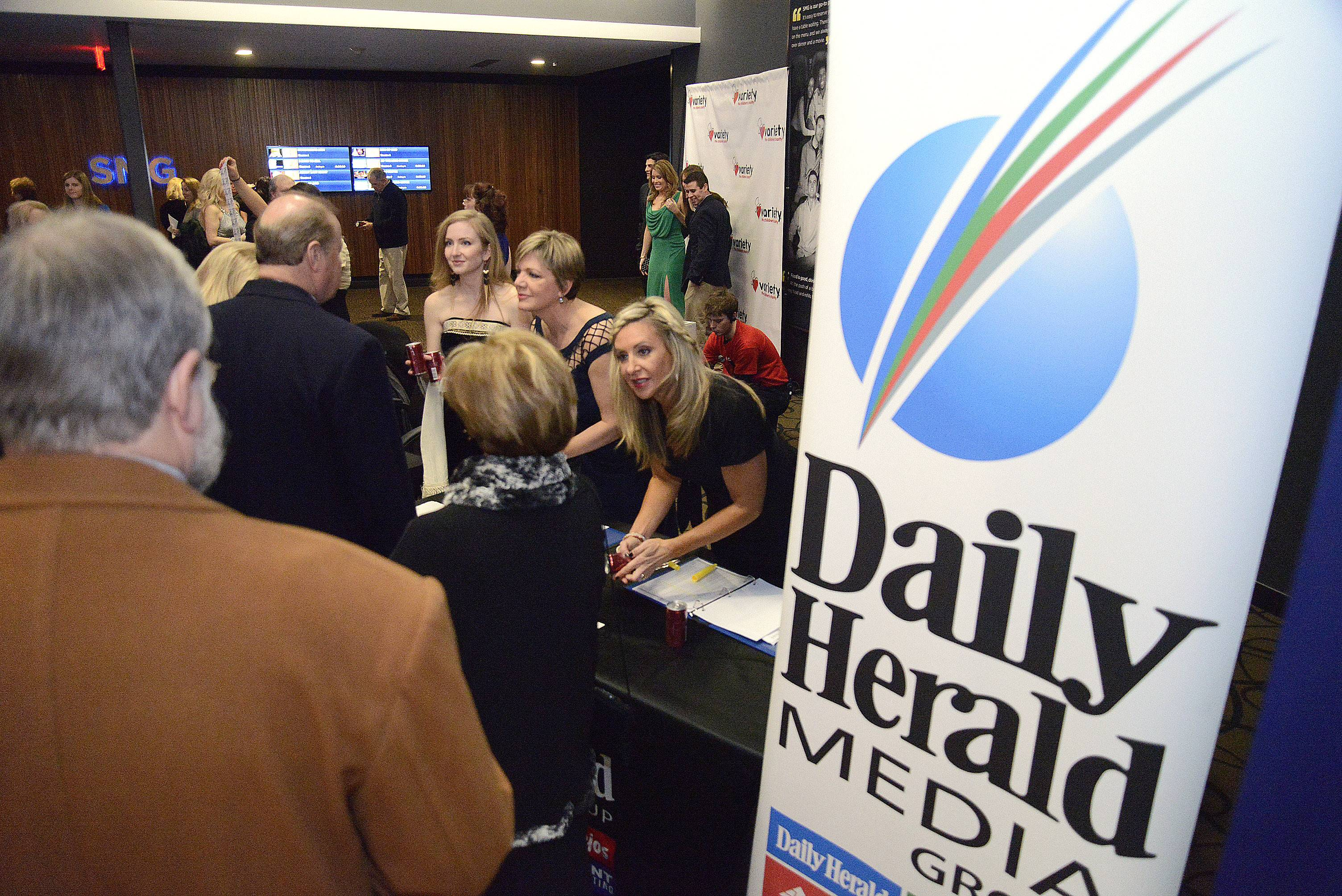 Daily Herald subscribers check in with Andrea Biewer at the 86th Academy Awards party hosted by Dann Gire at the Studio Movie Grill in Wheaton on Sunday, March 2.