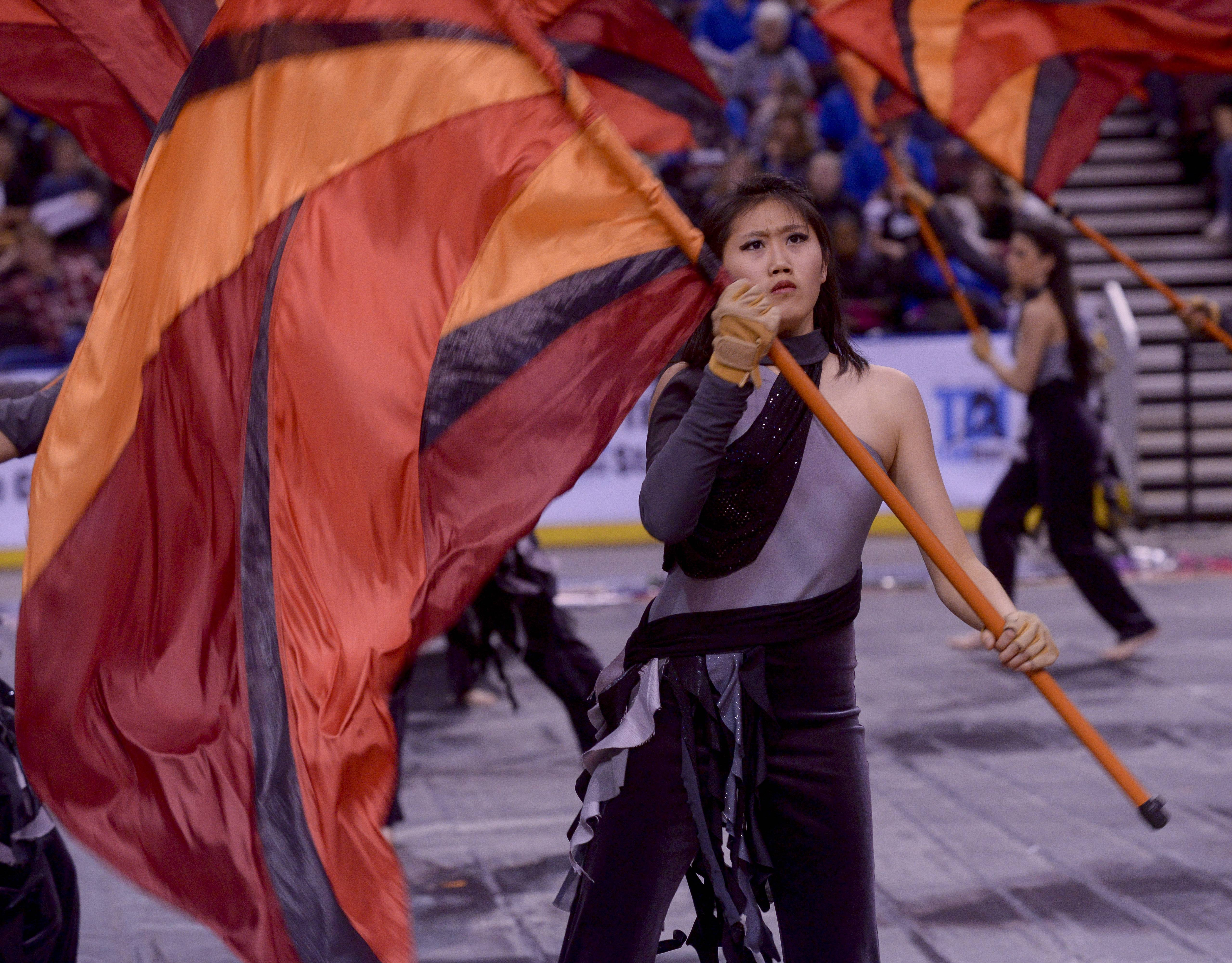Hoffman Estates High School performs in the Varsity Flag Winterguard Show category during the TEAMDance Illinois 2014 Grand Championship in Peoria, Sunday March 2nd.