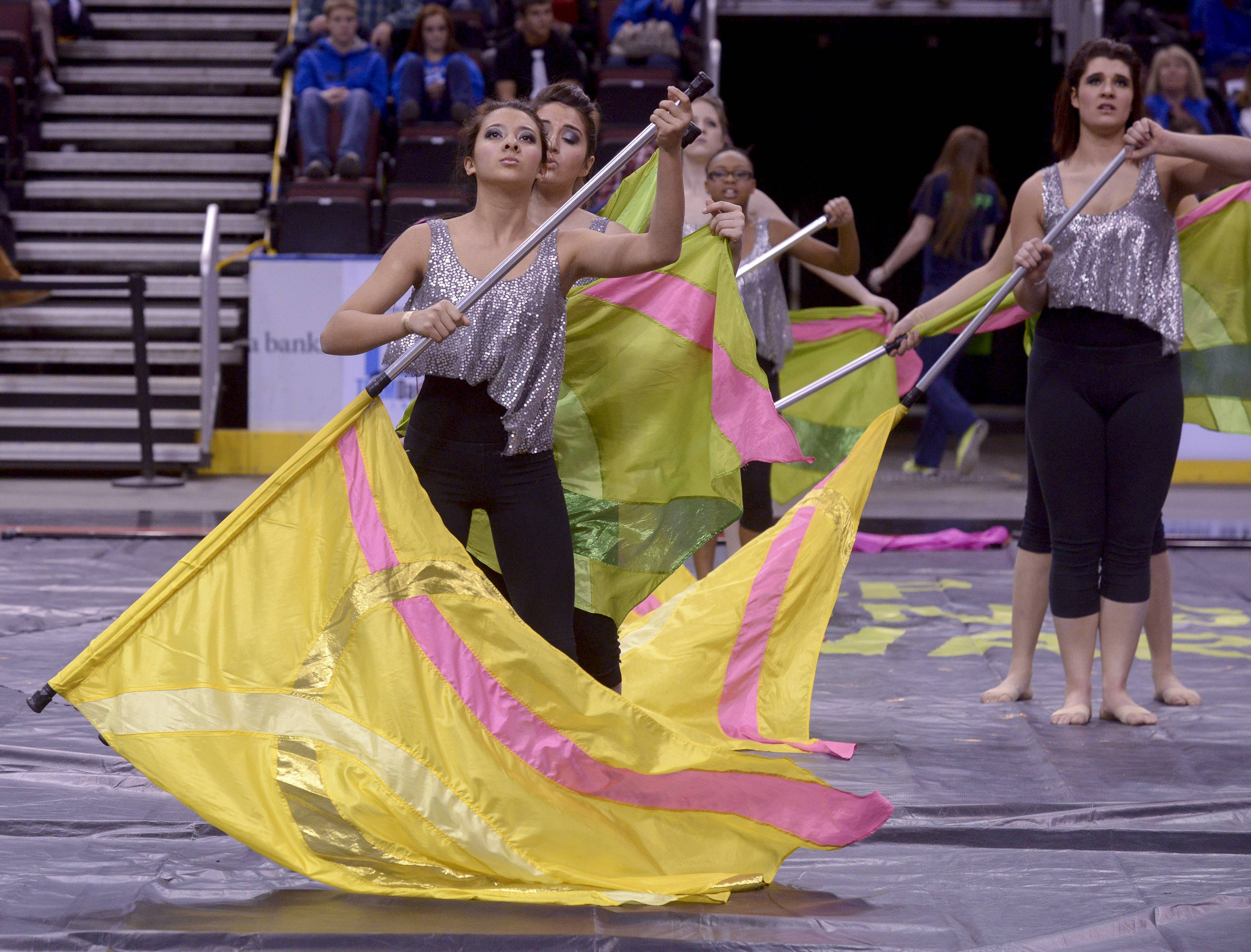 Schaumburg High School performs in the Varsity Flag Winterguard Show category during the TEAMDance Illinois 2014 Grand Championship in Peoria, Sunday March 2nd.