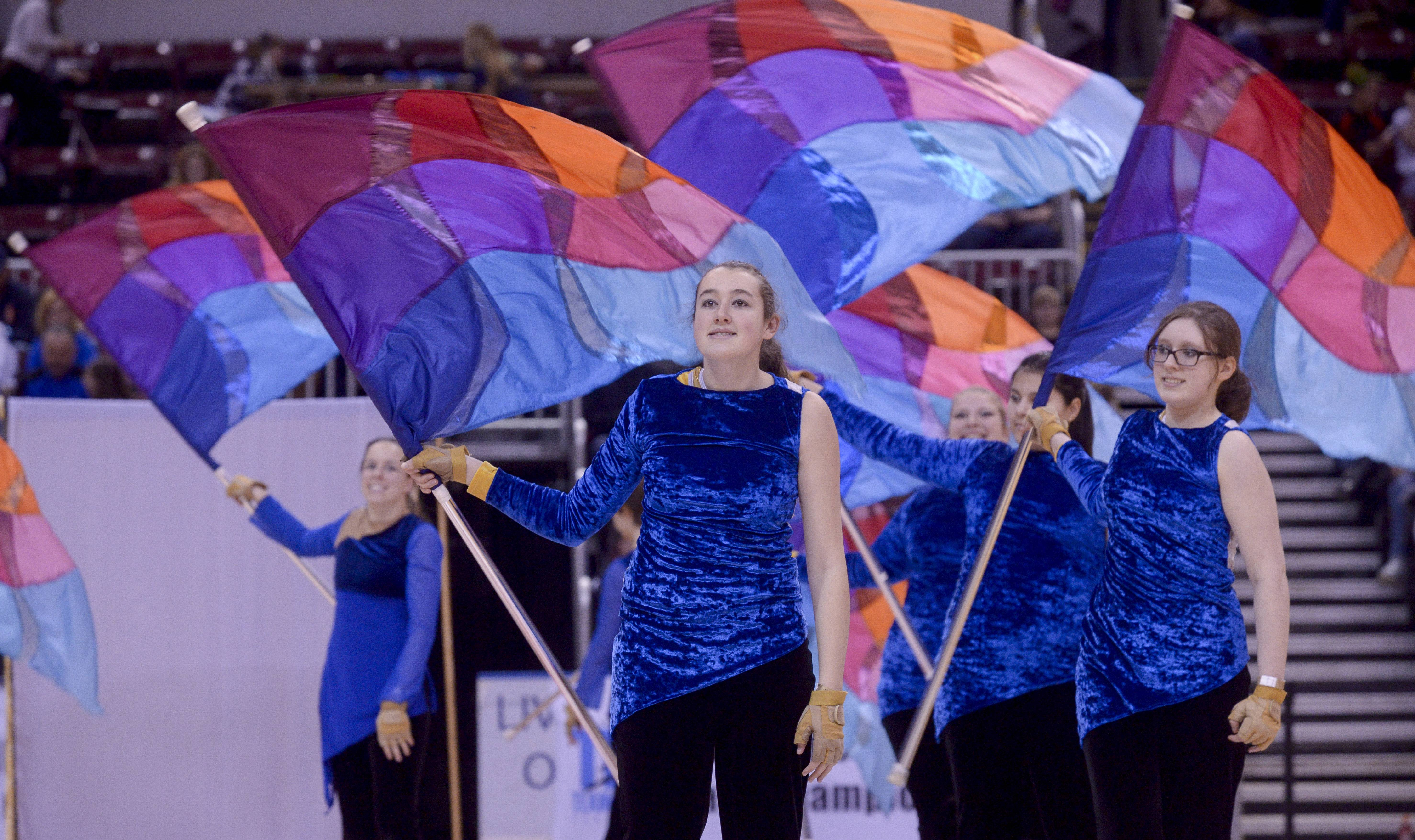 Mundelein High School performs in the Varsity Flag Winterguard Show category during the TEAMDance Illinois 2014 Grand Championship in Peoria, Sunday March 2nd.