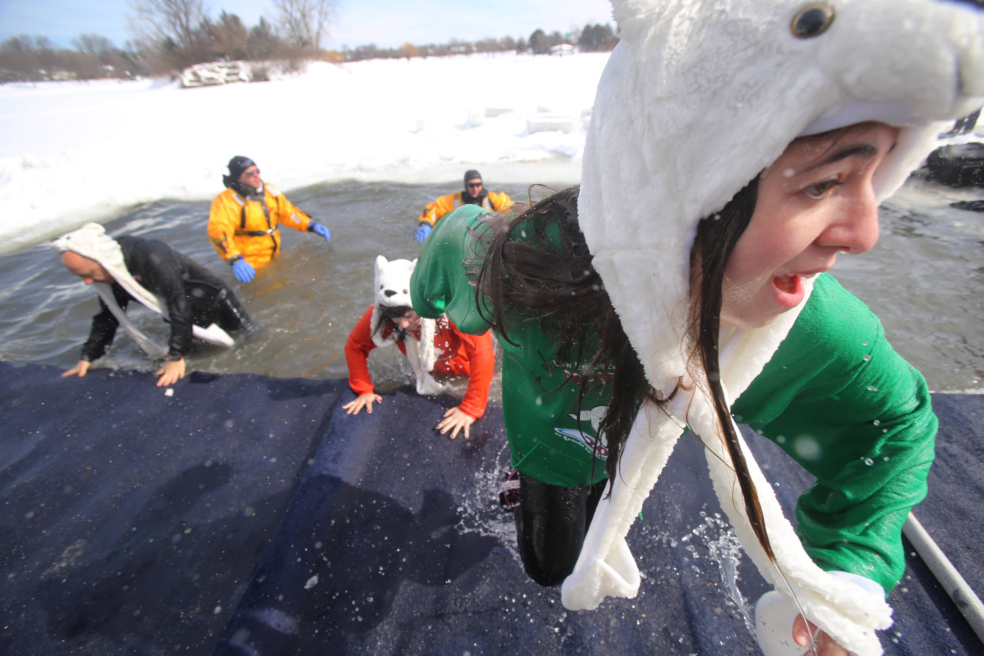 Alex Laner of Buffalo Grove can't get out of the water fast enough Sunday during the Polar Plunge at Twin Lakes Recreation Area in Palatine. The event raised more than $100,000 for Special Olympics.