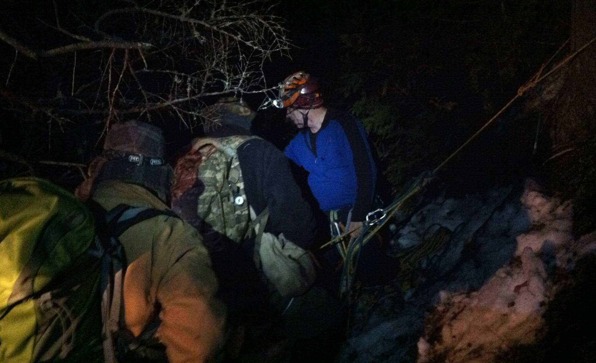 This photo provided by the Maine Warden Service, shows four professional climbers lowering a group of three Boy Scouts and two of their adult leaders down from the side of Black Cap Mountain in Eddington, Maine, early Sunday, Feb. 23, 2014.