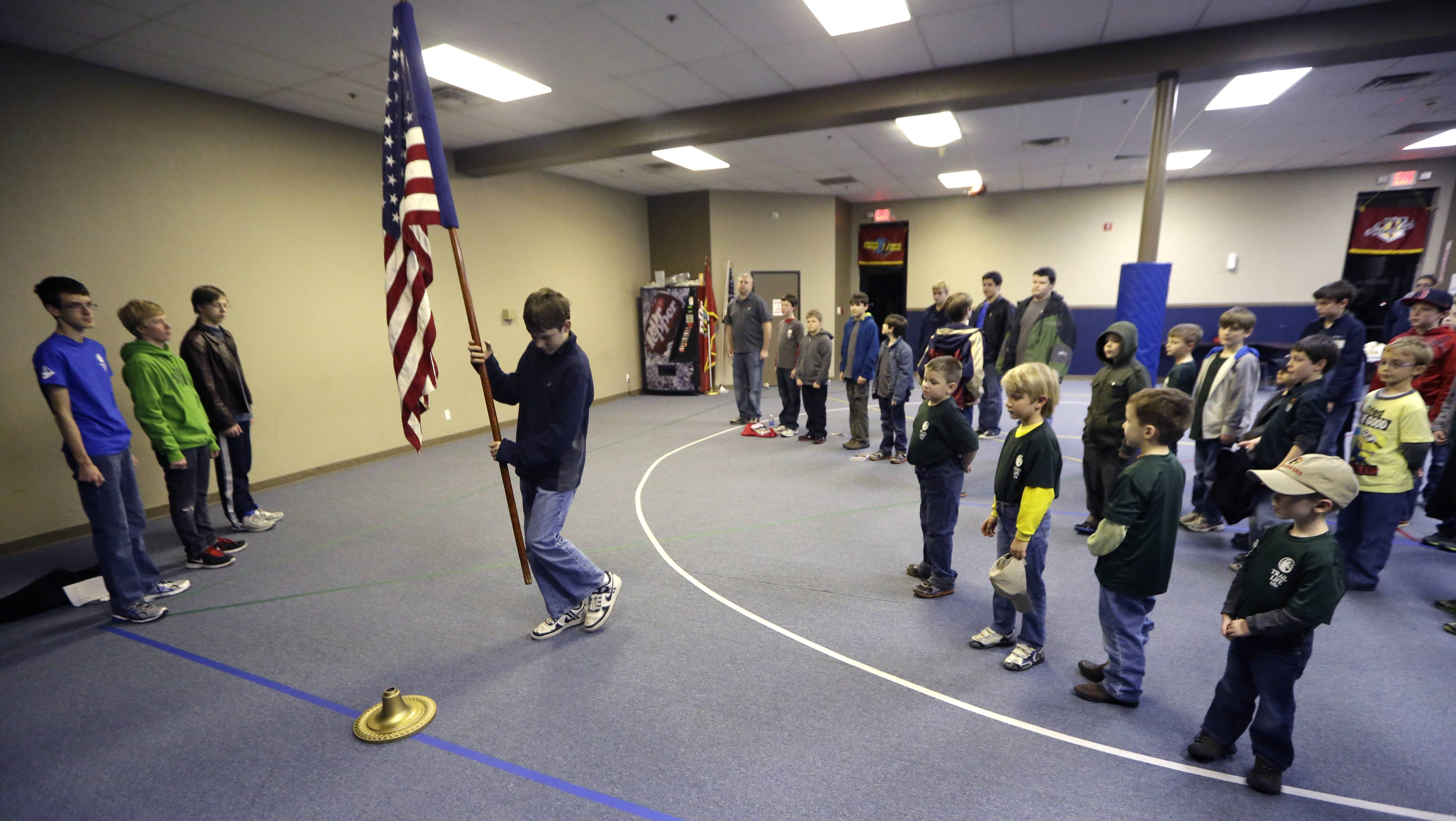 In this Tuesday, Feb. 4, 2014 photo, Trail Life members present a U.S. flag at the opening of meeting in North Richland Hills, Texas. Trail Life USA, the new Christian-based alternative to the Boy Scouts of America, excludes openly gay members.