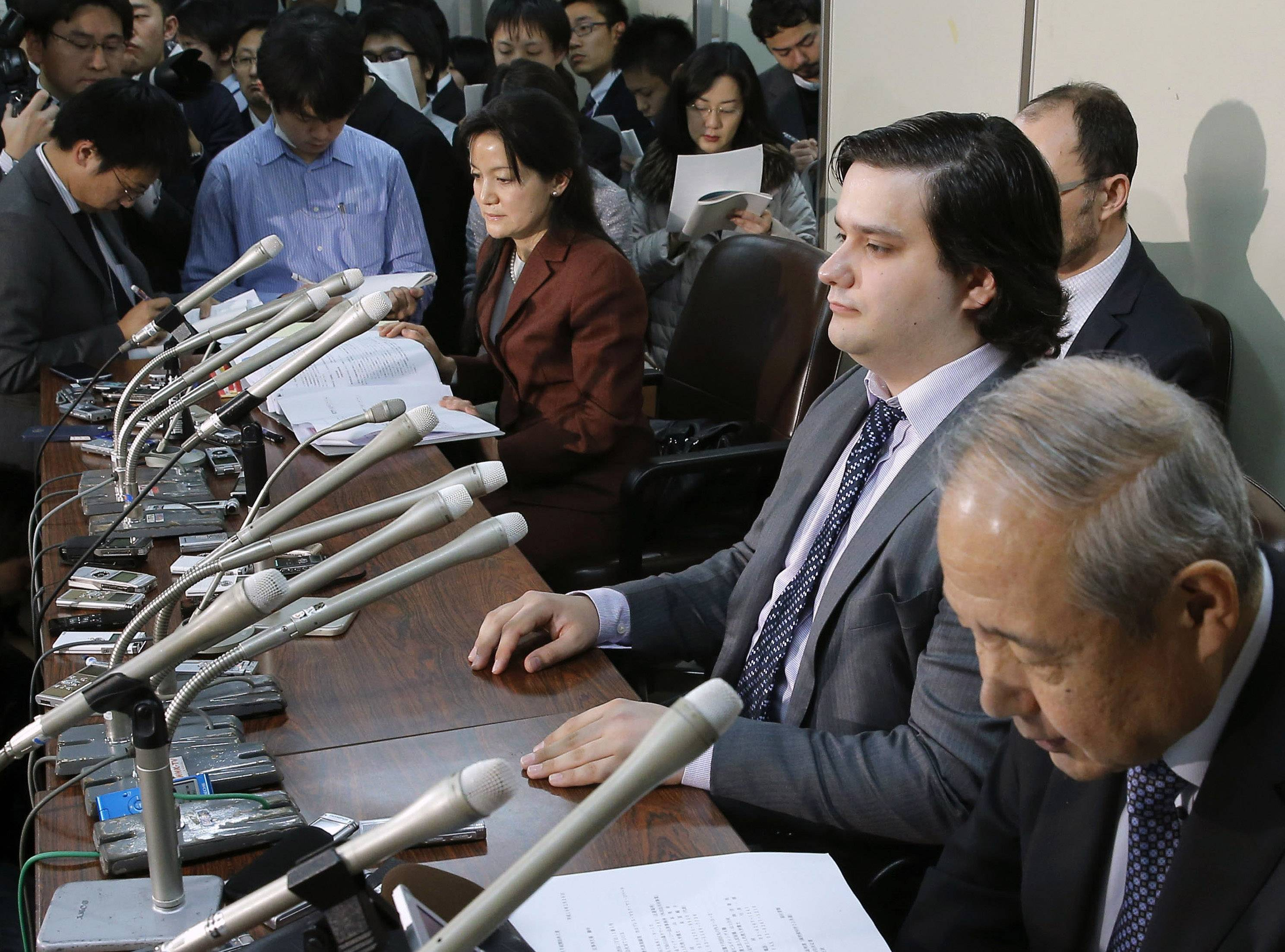 The Tokyo bitcoin exchange Mt. Gox that filed for bankruptcy protection blamed theft through hacking for its losses Monday. Mt. Gox CEO Mark Karpeles, sitting at second right, is seen here at a press conference in on Feb. 28, 2014.