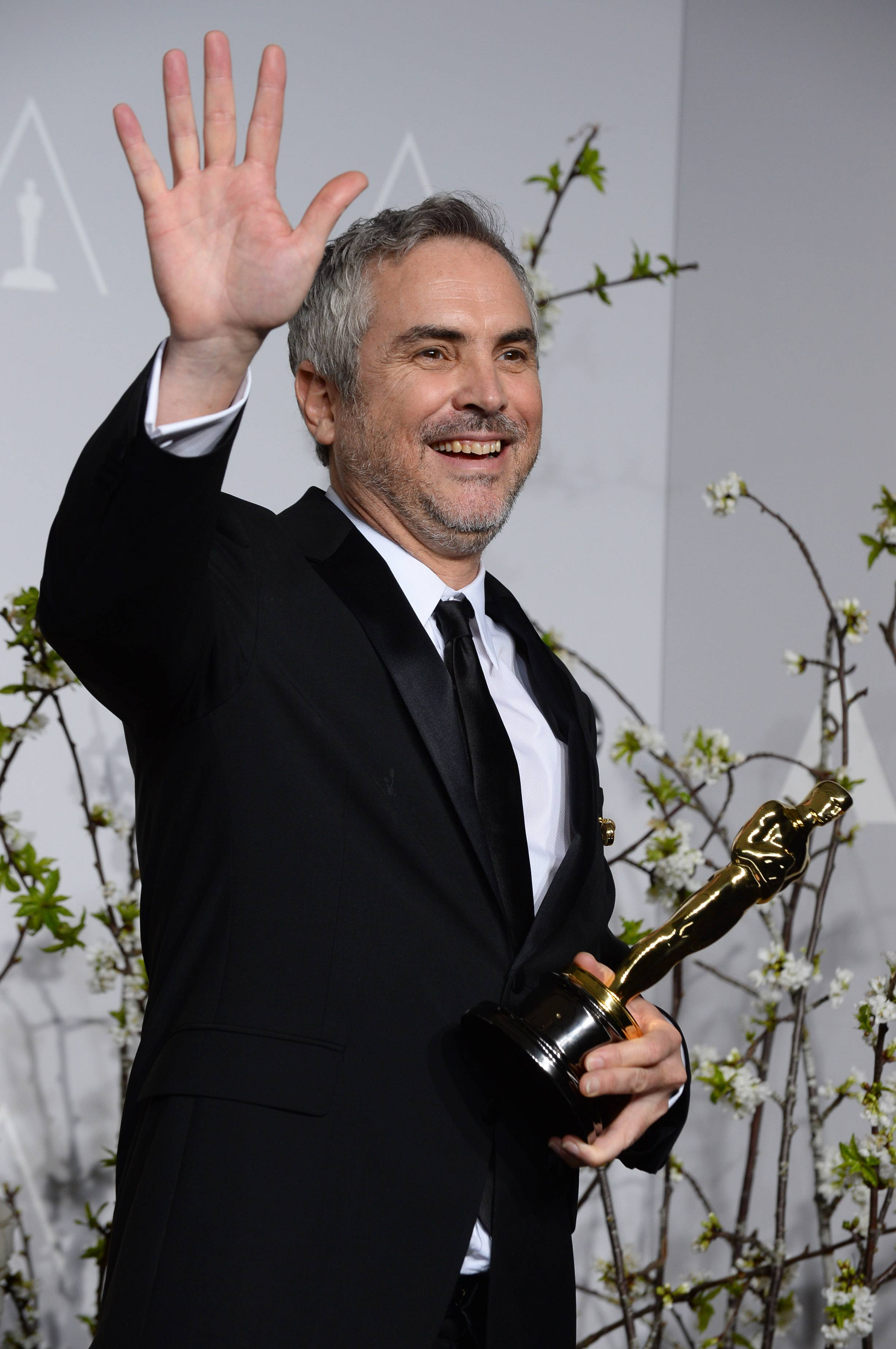 "Alfonso Cuaron poses with the award for best film editing for ""Gravity"" during the Oscars Sunday. ""I'm Mexican so I hope some Mexicans were rooting for me,"" he told reporters backstage."