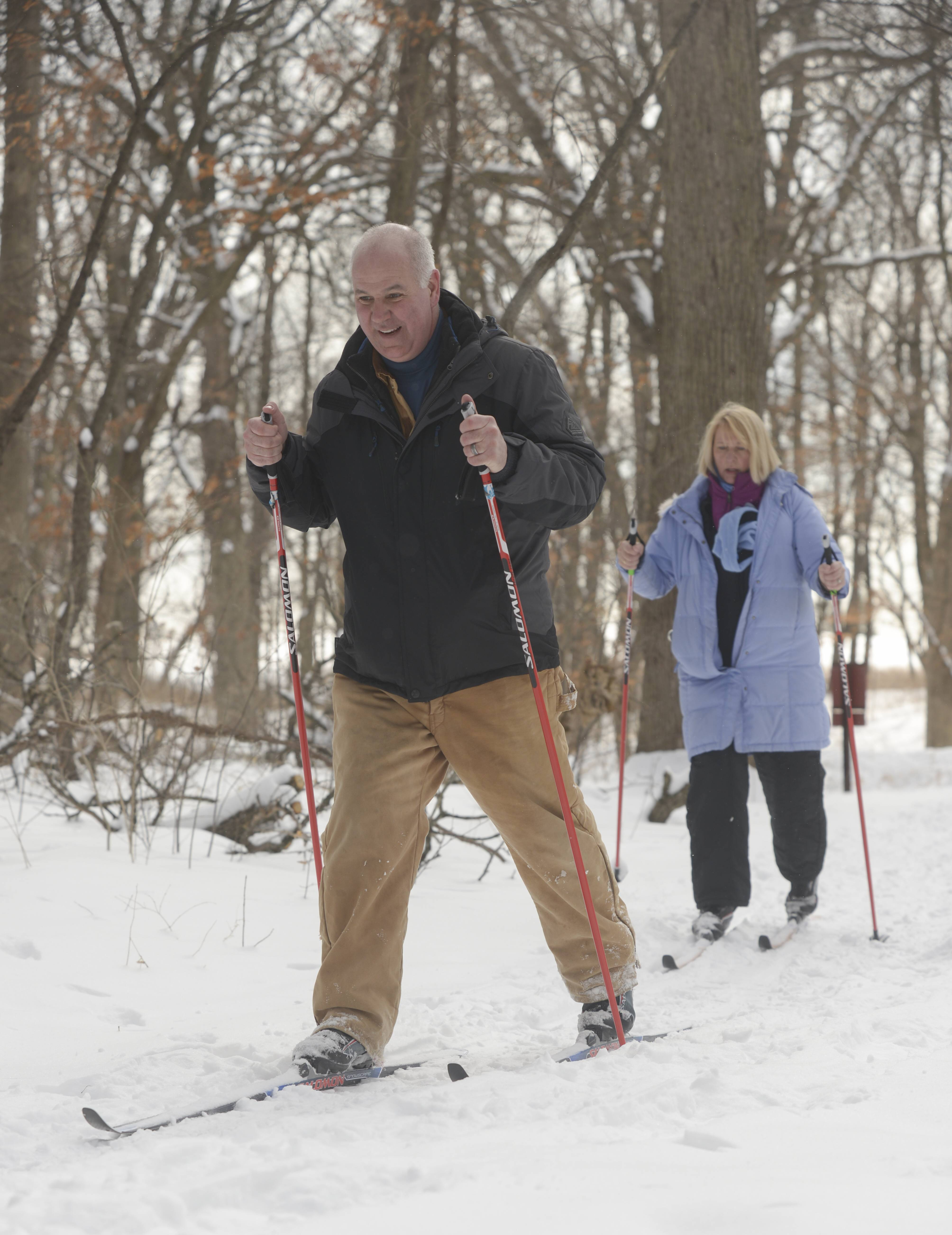 Greg and Maredith Stoffel of Batavia venture into the woods Monday along one of the many trails at the Morton Arboretum in Lisle to do a bit of cross-country skiing. Maredith had not skied in 15 years and Greg had never tried it before.