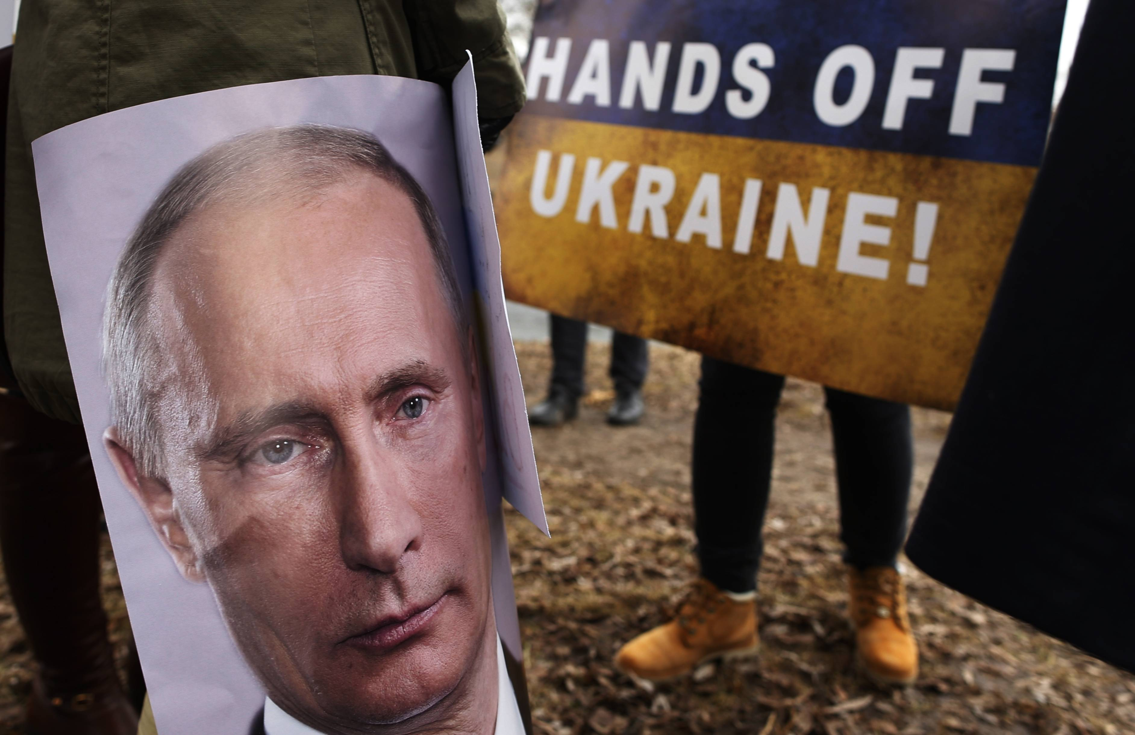 Demonstrators gather Monday outside the Russian Embassy in Vilnius, Lithuania, to protest against Russian intervention in Ukraine. The U.S. and its allies are weighing sanctions on Moscow and whether to bolster defenses in Europe in response to Russia's military advances on Ukraine.