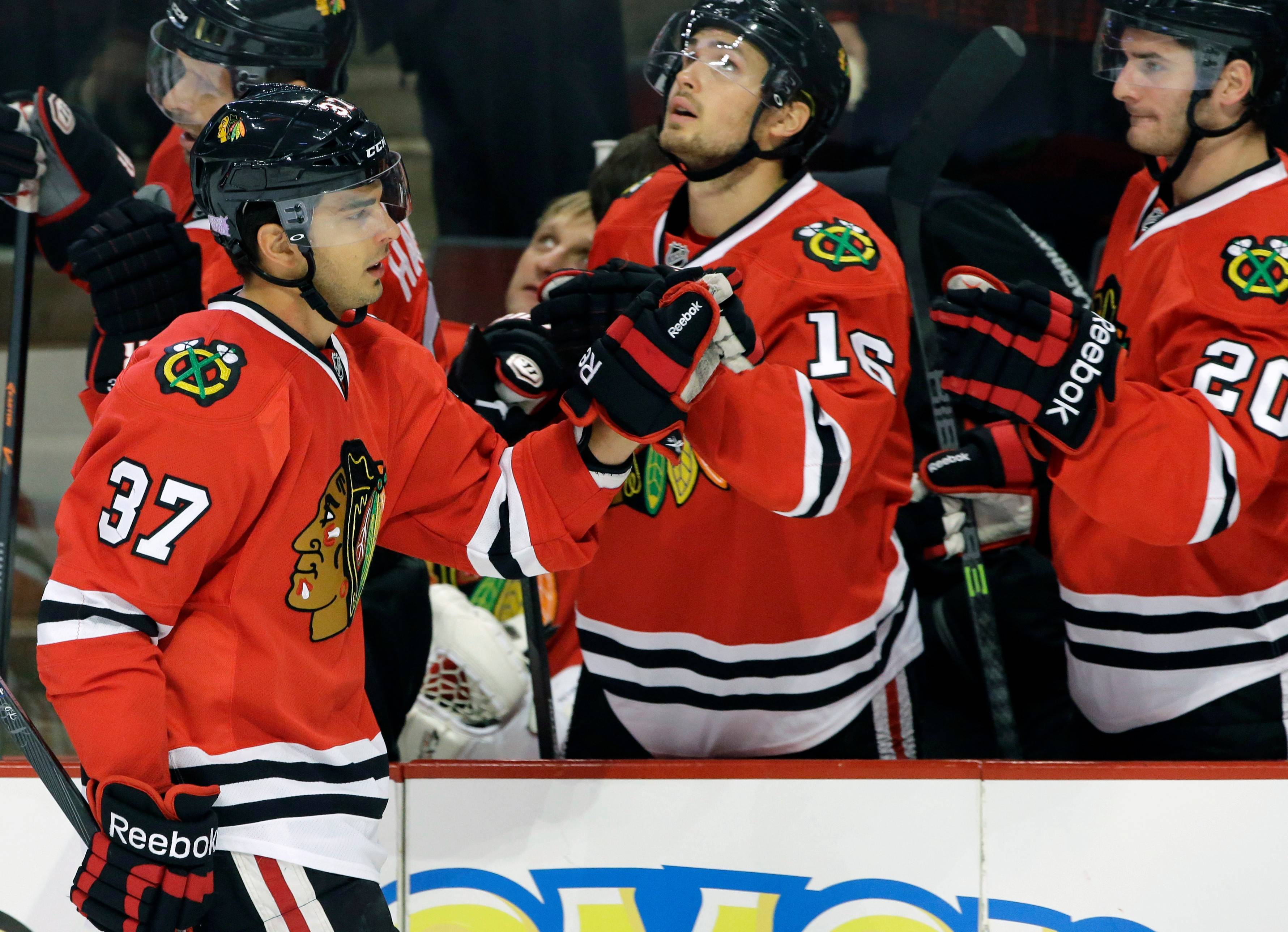 Chicago Blackhawks' Brandon Pirri (37) celebrates with teammates after scoring a goal during the first period of an Oct. 17 NHL hockey game against the St. Louis Blues in Chicago.