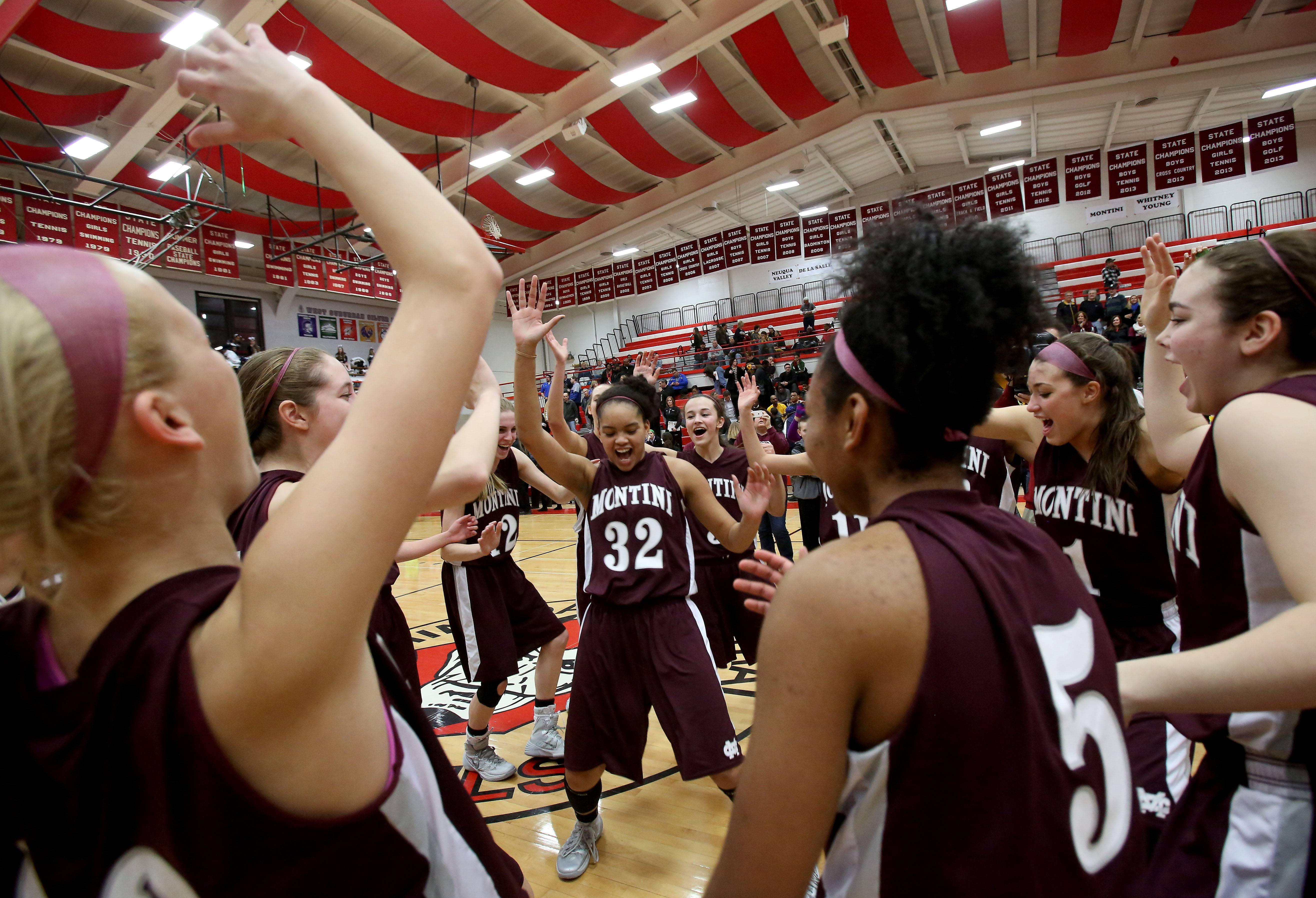 Montini celebrates in their 59-27 win over De La Salle in Class 3A supersectional girls basketball at Hinsdale Central on Monday.
