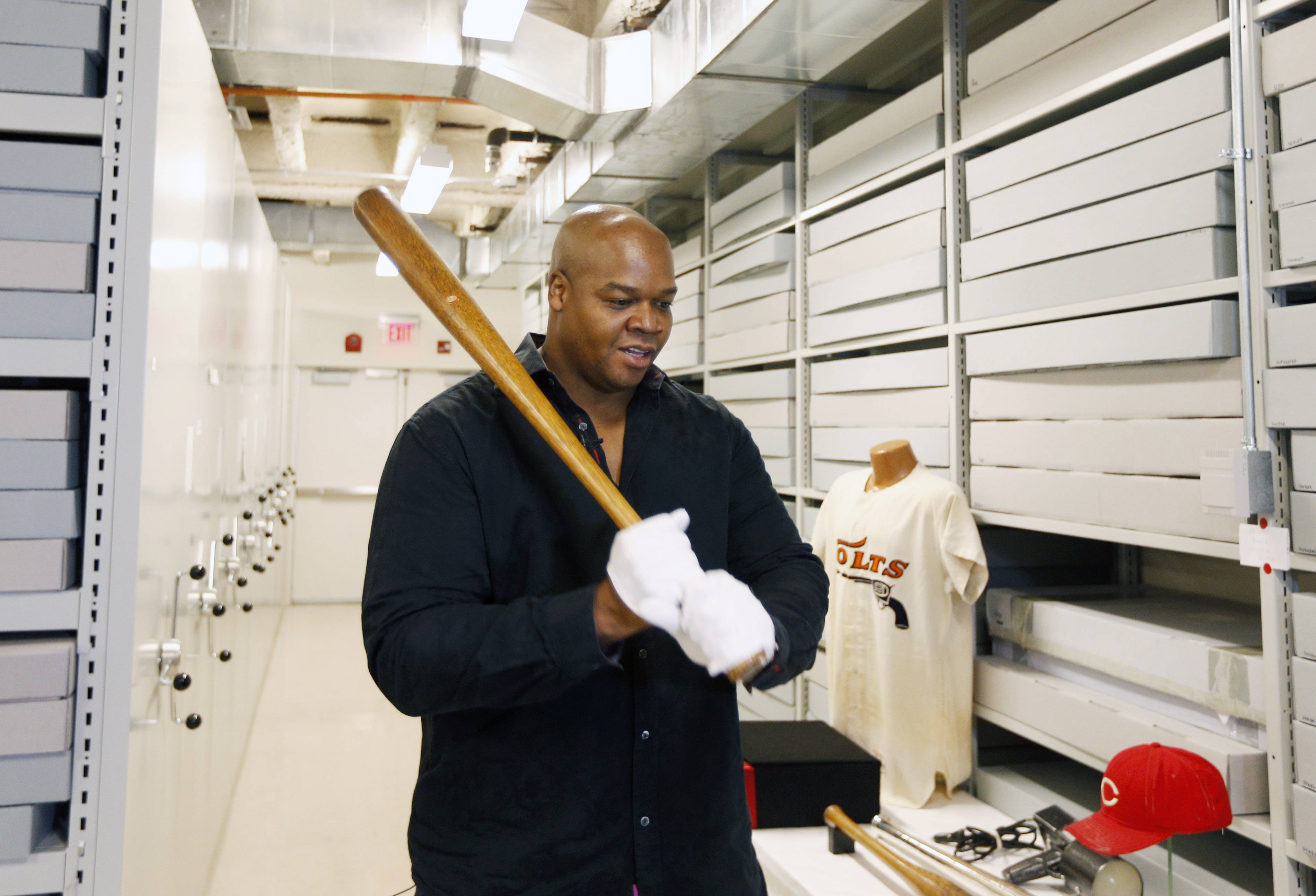 Former White Sox slugger Frank Thomas holds a Babe Ruth bat in the archives area Monday during his orientation visit at the Baseball Hall of Fame in Cooperstown, N.Y. Thomas will be inducted to the hall in July.