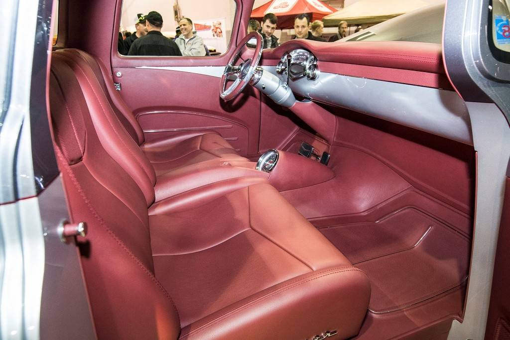 Inside the 1957 Chevy, the bench seat is long gone, and the interior shines as new as the exterior.