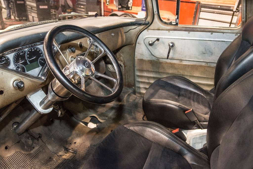 The 1959 Chevy's interior retains its well-worn look, with the exception of new seats, gauges and steering wheel.