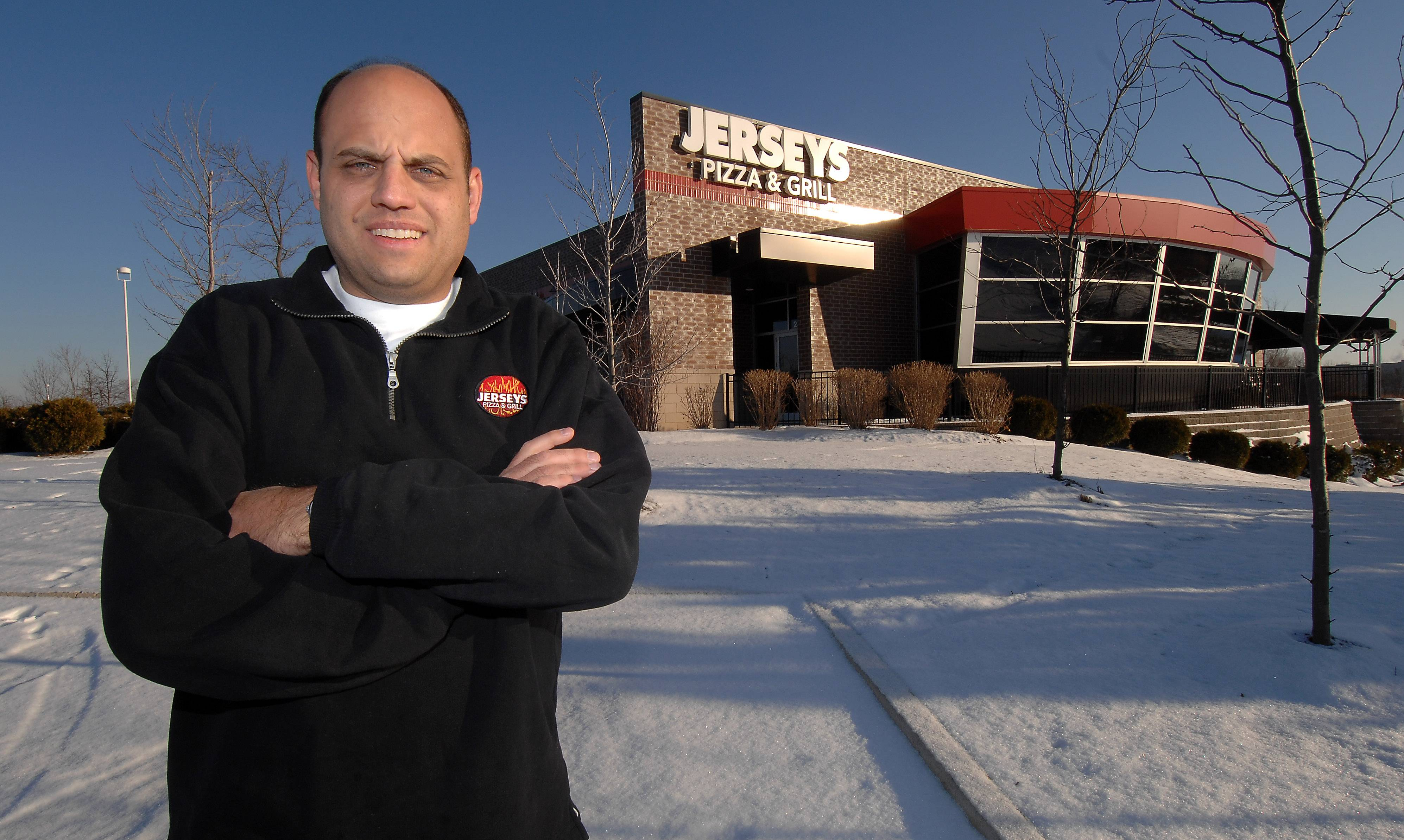 Mark Welsh Daily Herald File photo Gregg Majewski, owner of Jerseys Pizza and Grill restaurant in Hoffman Estates stands in front of his restaurant in this file photo.