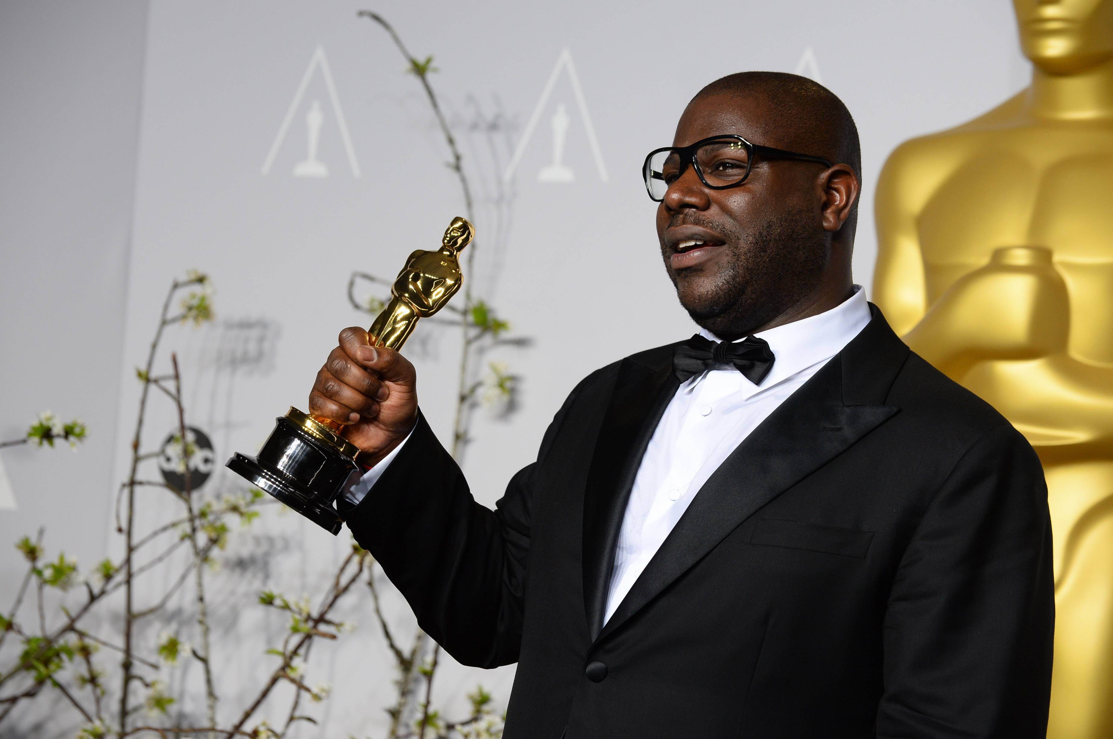 "Director Steve McQueen poses with the award for best picture for ""12 Years a Slave"" during the Oscars at the Dolby Theatre on Sunday in Los Angeles."