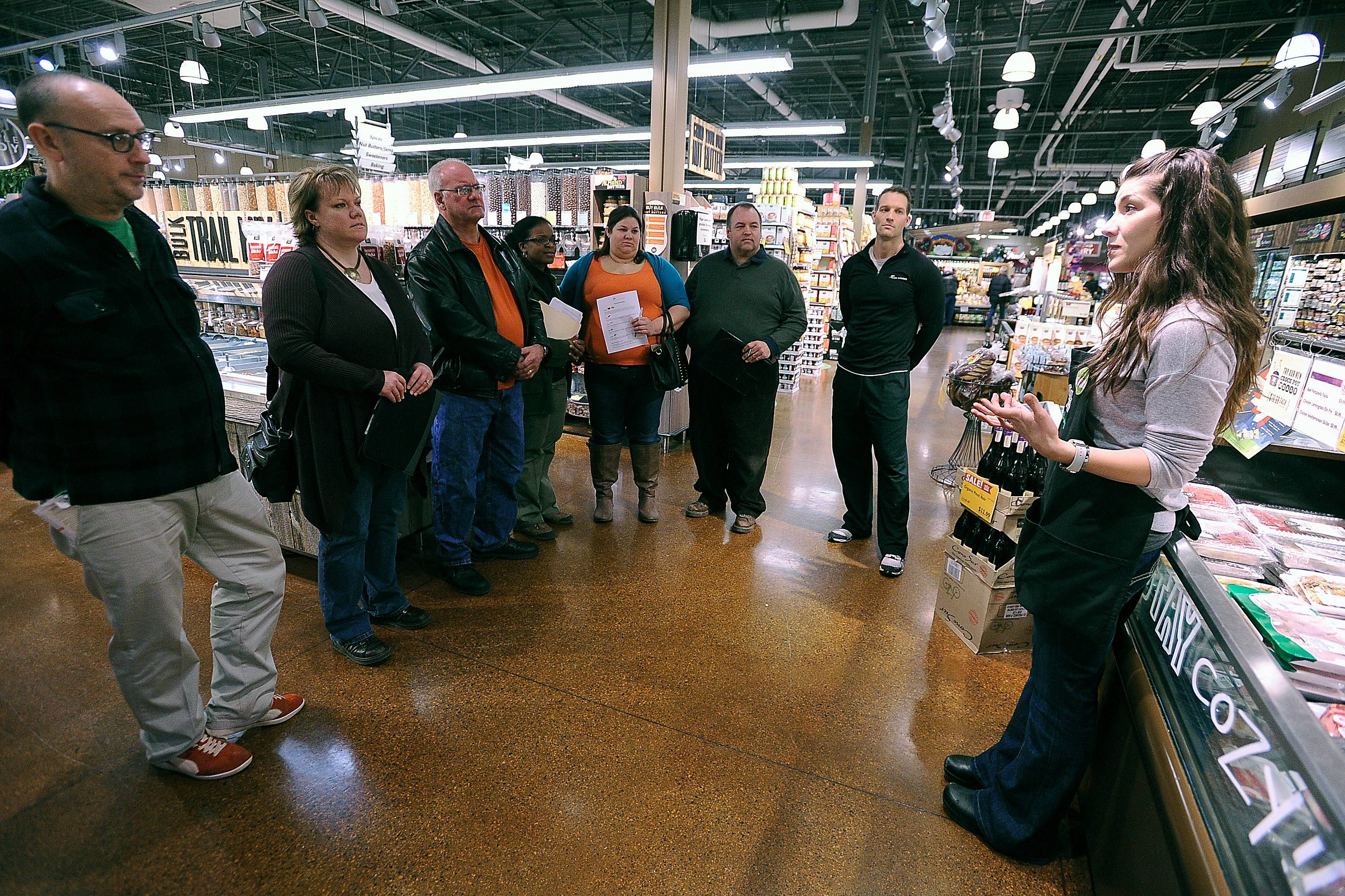Whole Foods Market Assistant Marketing Specialist Tatiyana Baukovic offers shopping and nutrition tips as the Fittest Loser Challenge contestants tour the Schaumburg store.