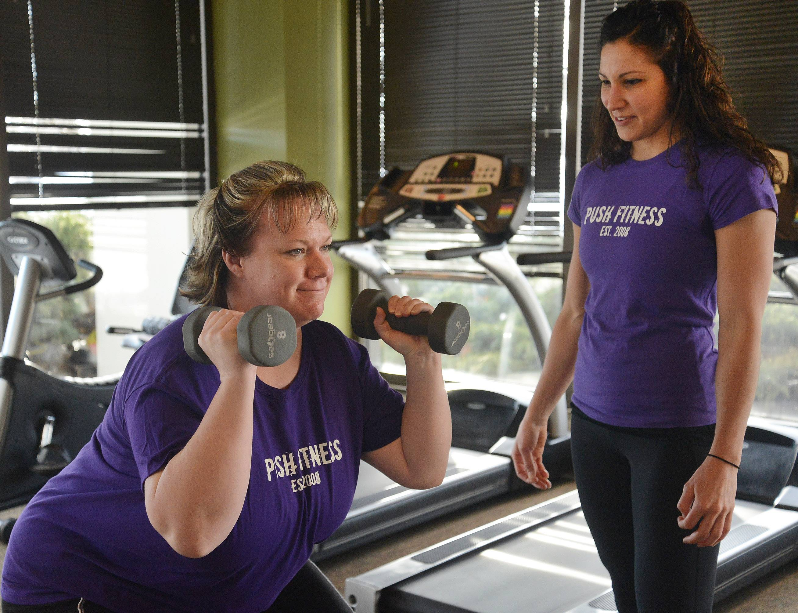 Bob Chwedyk/bchwedyk@dailyherald.comCheryl Siebert, left, works out with her trainer Lindsay Vigna. Before shots of the Fittest Loser contestants and their trainers.