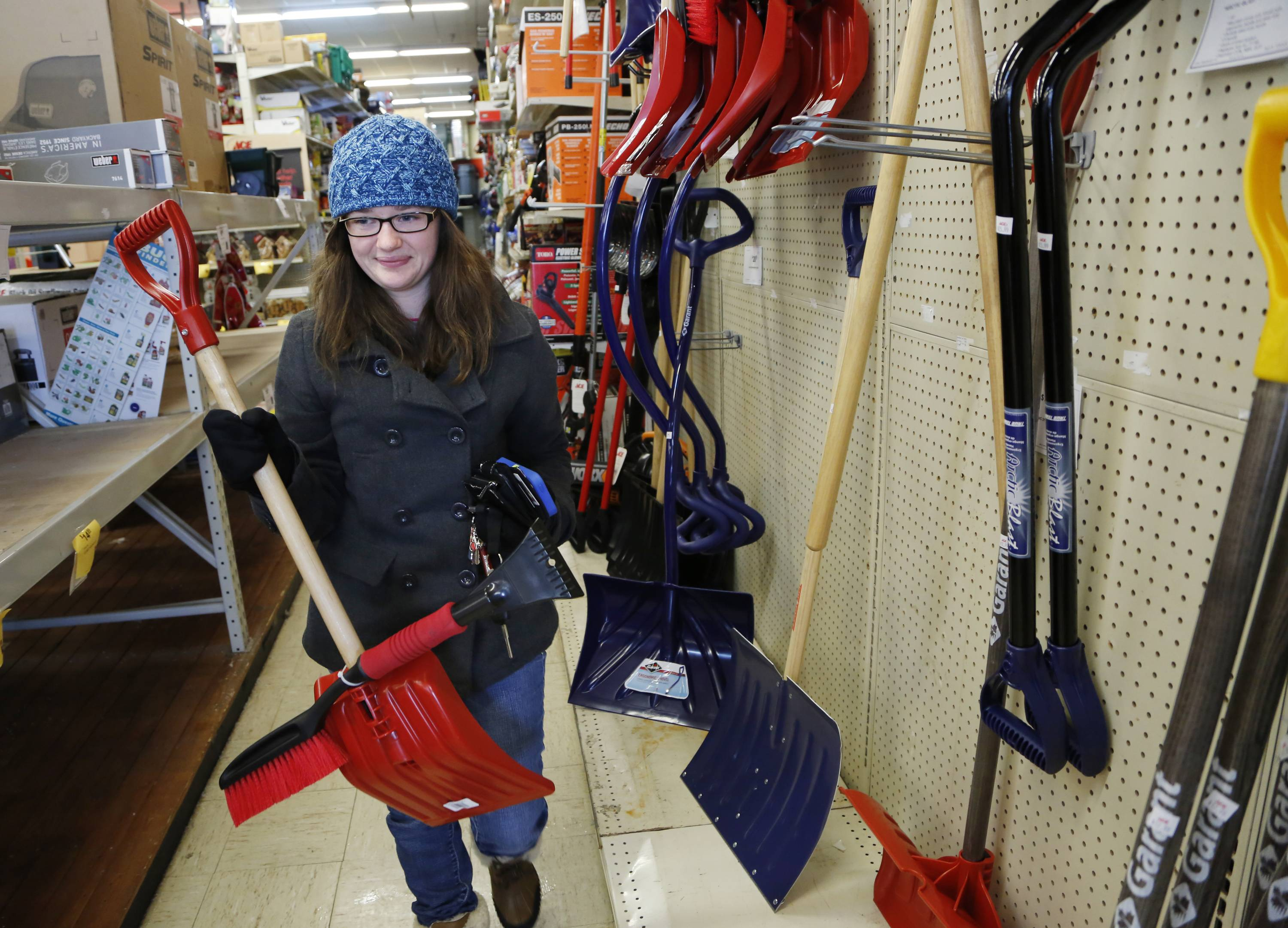 Coleen Riley purchases a snow shovel at Ace Hardware, in West Lafayette, Ind. Harsh winter weather has been rough for some businesses, but for a lucky few, it has meant more hard, cold cash. Ace Hardware is having its best winter in more than a decade selling snowblowers and shovels.