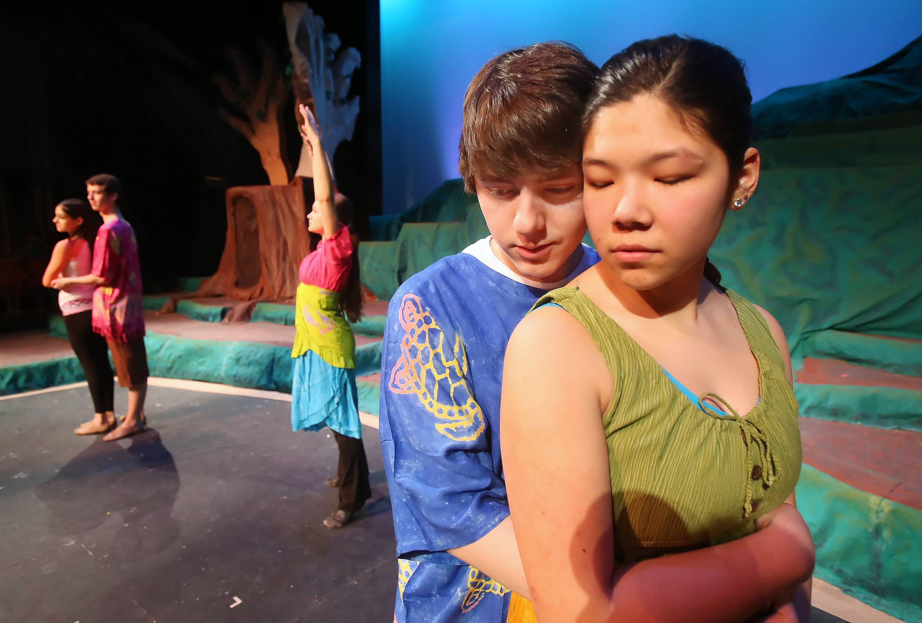 "Leads Pauline Moll, right, playing Ti Moune, and Kyle Fisher, playing Daniel, dance during Monday's dress rehearsal for the spring musical ""Once On This Island"" at Grayslake Central High School. Students from Grayslake Central and Grayslake North are participating on the play that will be performed March 13-16."