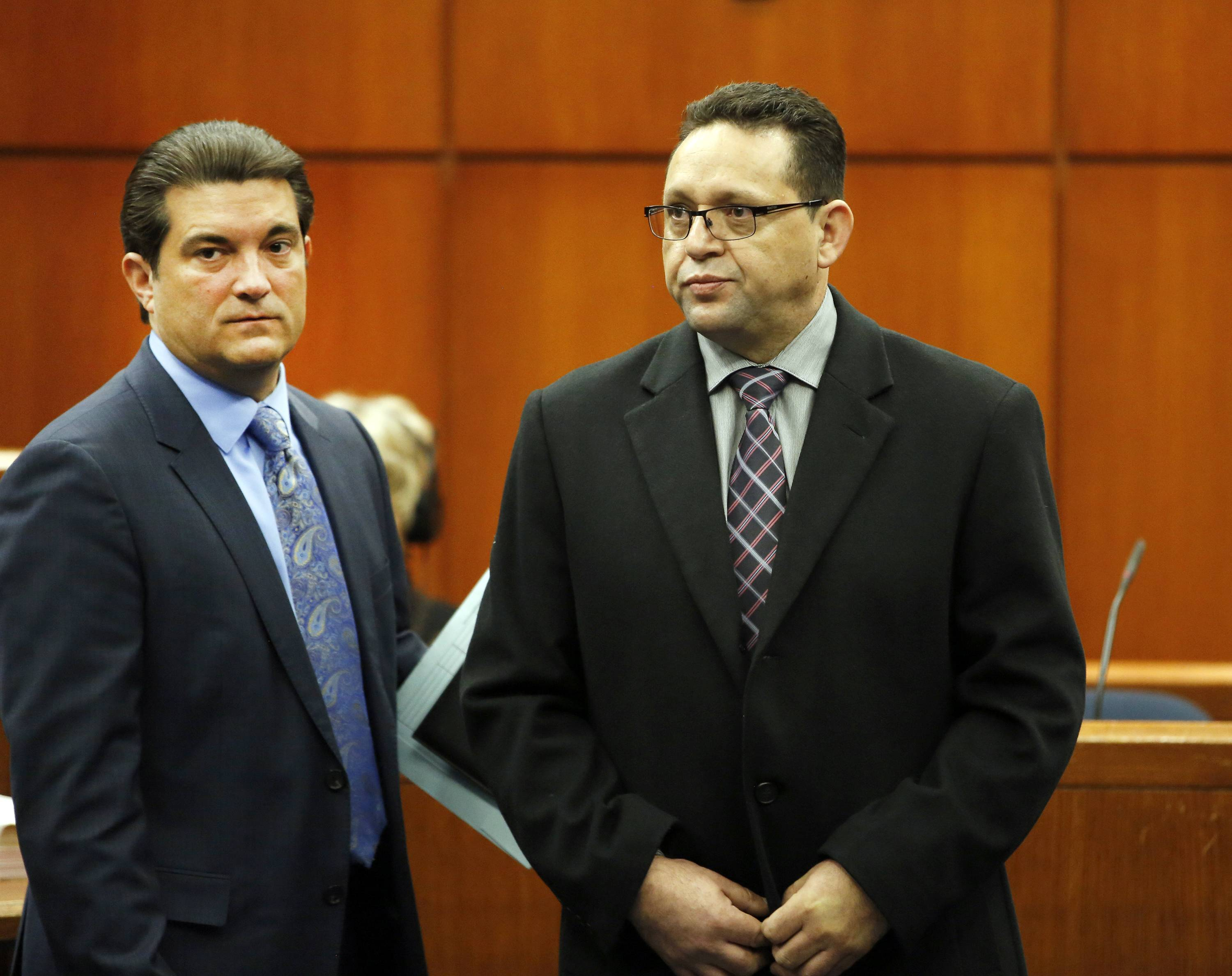 Truck driver Renato Velasquez, right, with his attorney Steven Goldman, is arraigned Monday in front of Judge Robert Kleeman at the DuPage County Courthouse in Wheaton. Velasquez was driving a semitrailer truck in January that struck emergency vehicles stopped along I-88, killing a tollway worker and injuring a state trooper.