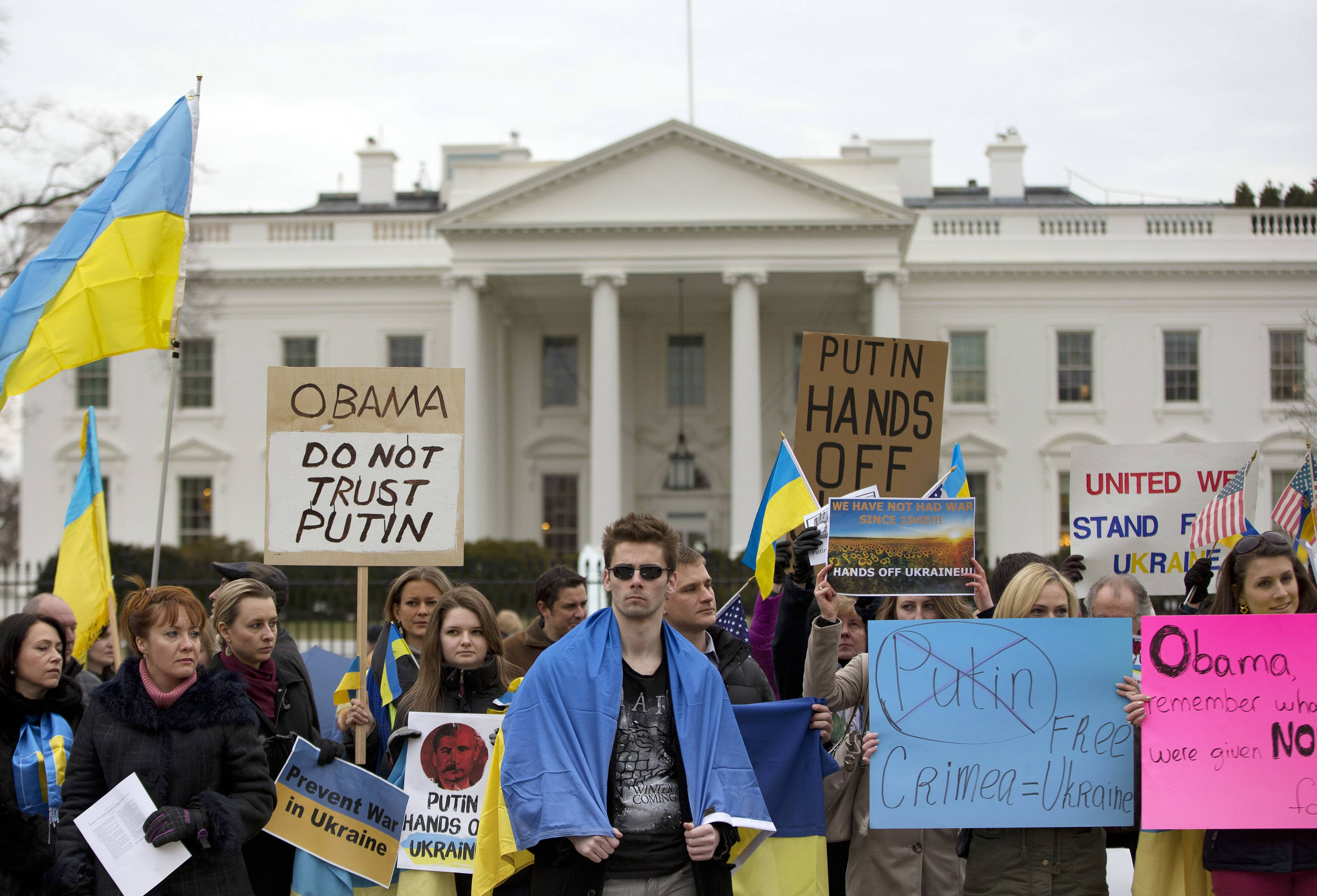 Demonstrators gather Saturday outside the White House in Washington. Russian troops took over Crimea as the parliament in Moscow gave President Vladimir Putin a green light Saturday to use the military to protect Russian interests in Ukraine.
