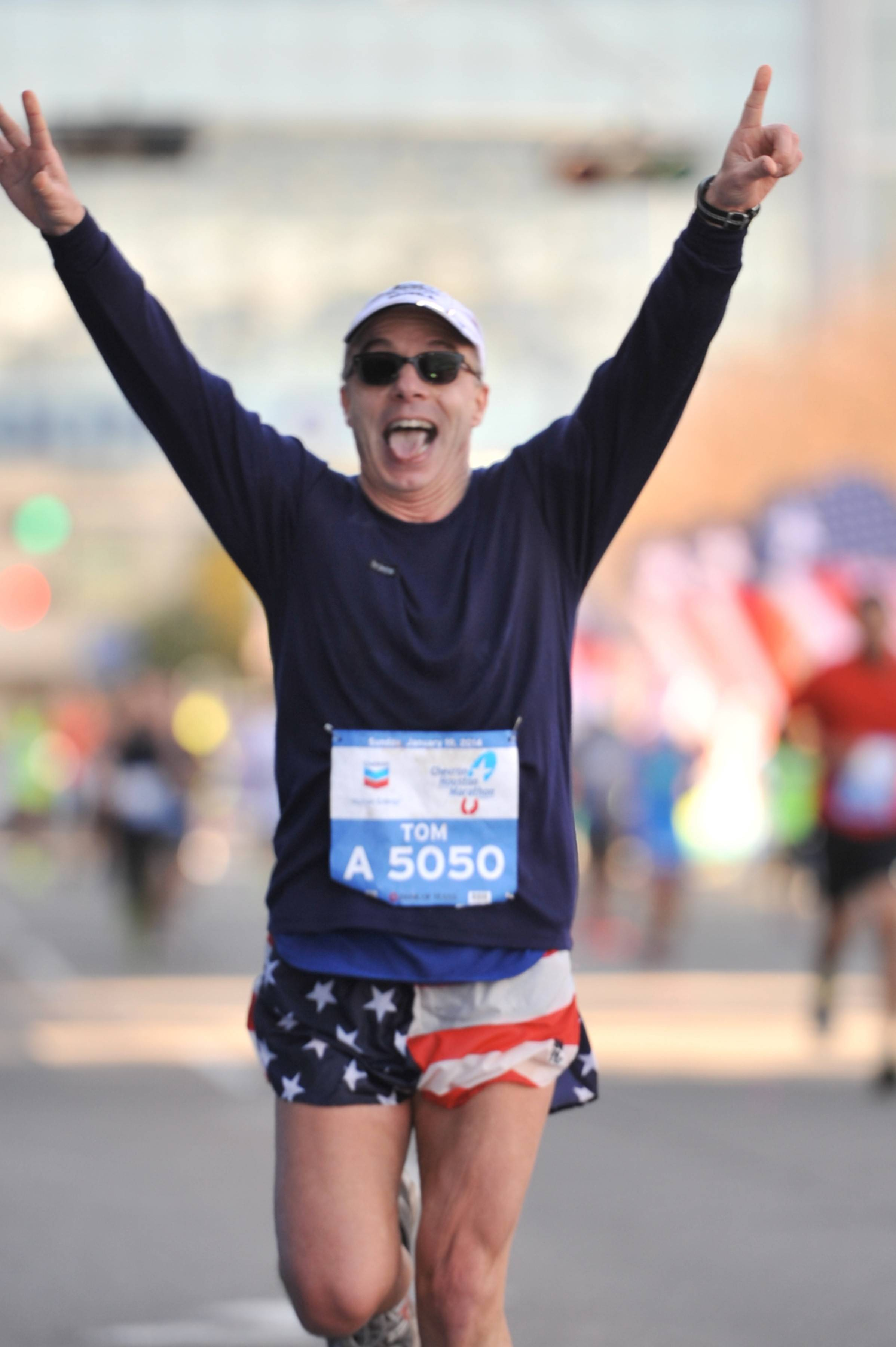 "Tom Minichiello of Naperville says he was in a ""state of happiness"" as he neared the finish line Jan. 19 in Texas for the final race in his quest to complete a marathon in less than four hours in all 50 states."