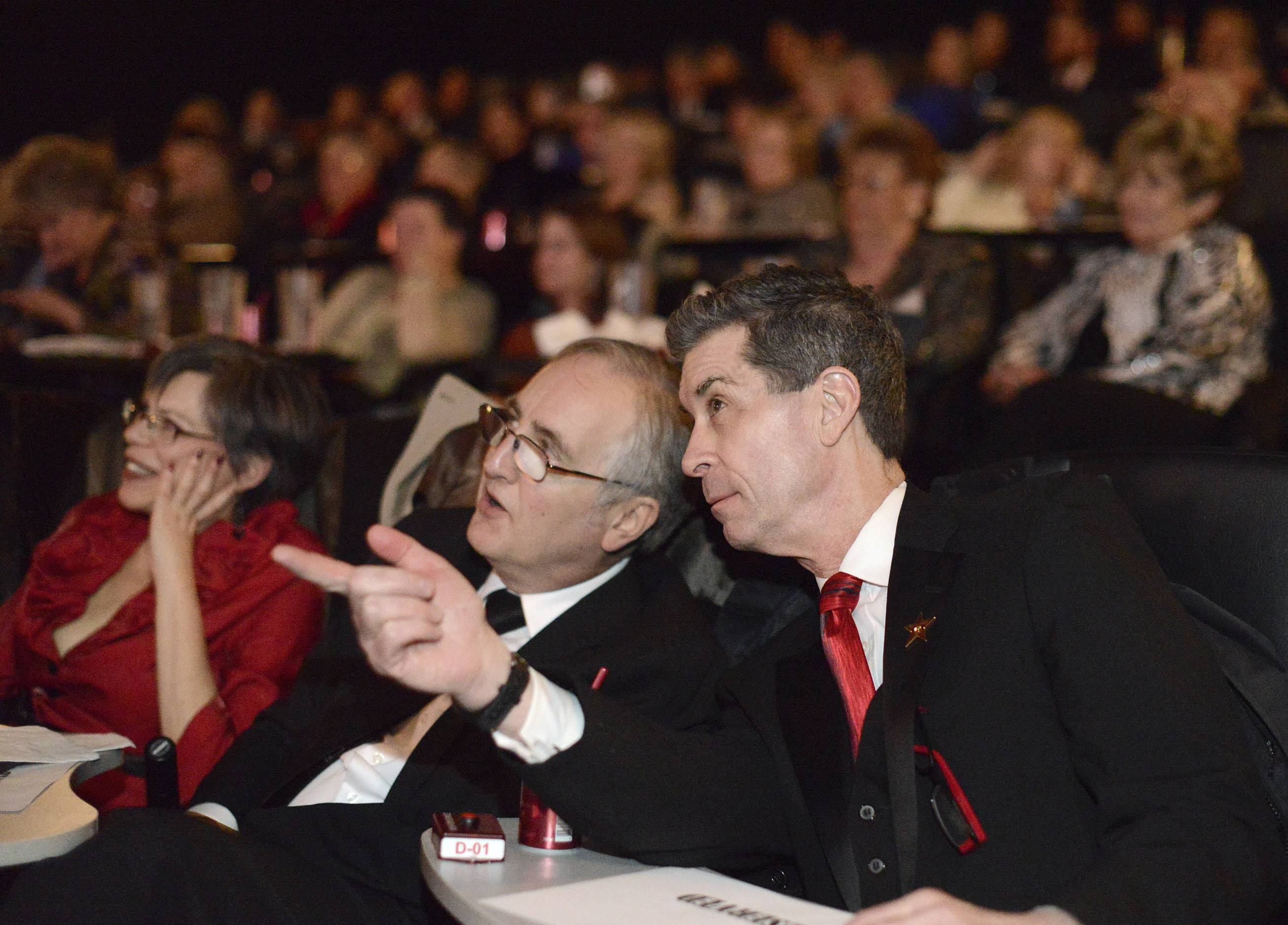 Raymond Benson of Buffalo Grove and the Daily Herald's Dann Gire chat as Jared Leto accepts the Best Supporting Actor Oscar (which they correctly predicted) as they host the 86th Academy Awards party for Daily Herald subscribers at Studio Movie Grill in Wheaton on Sunday, March 2.